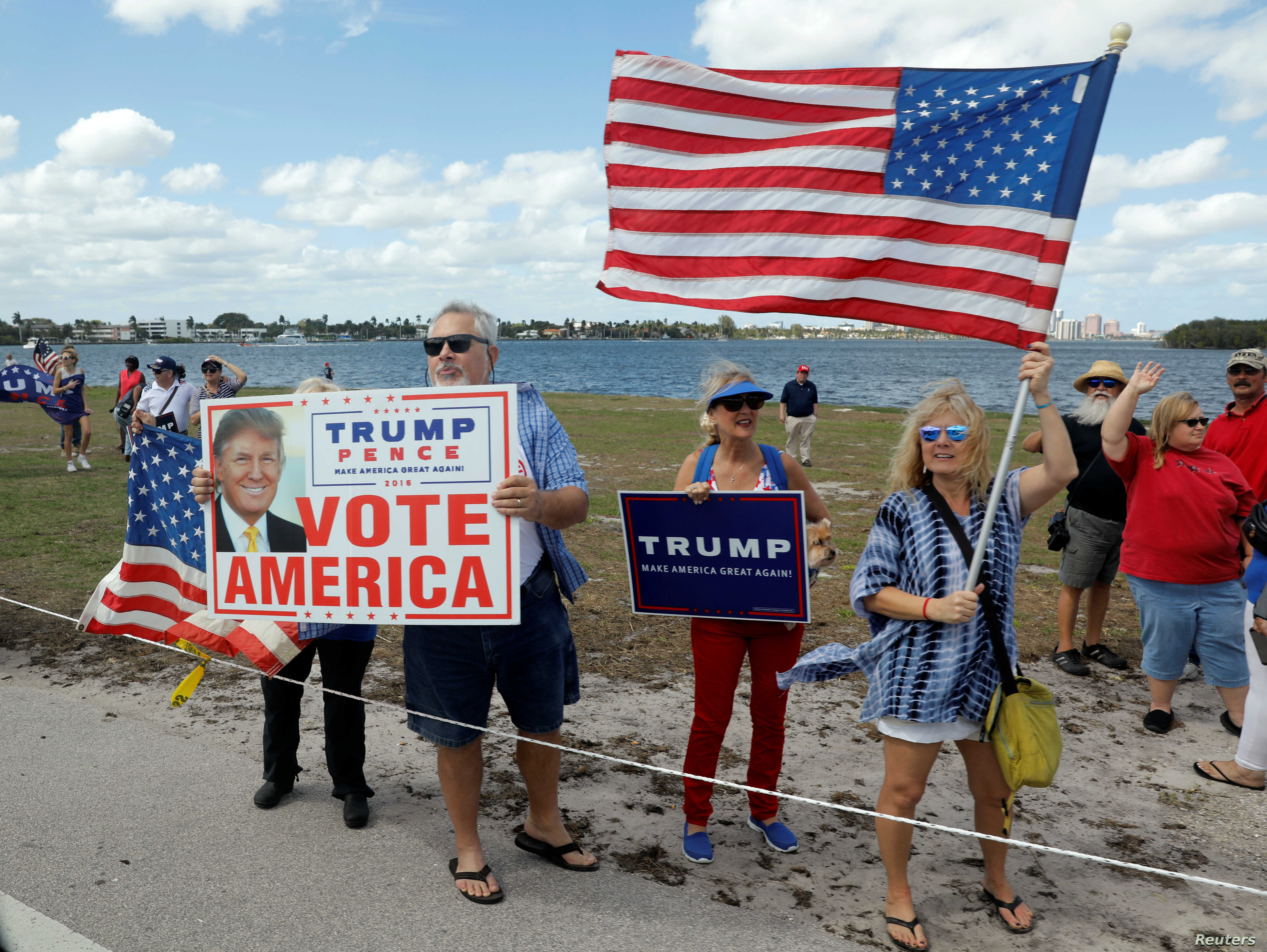 Supporters line President Donald Trump's motorcade route near the Mar-a-Lago Club in Palm Beach, Fla., March 4, 2017.