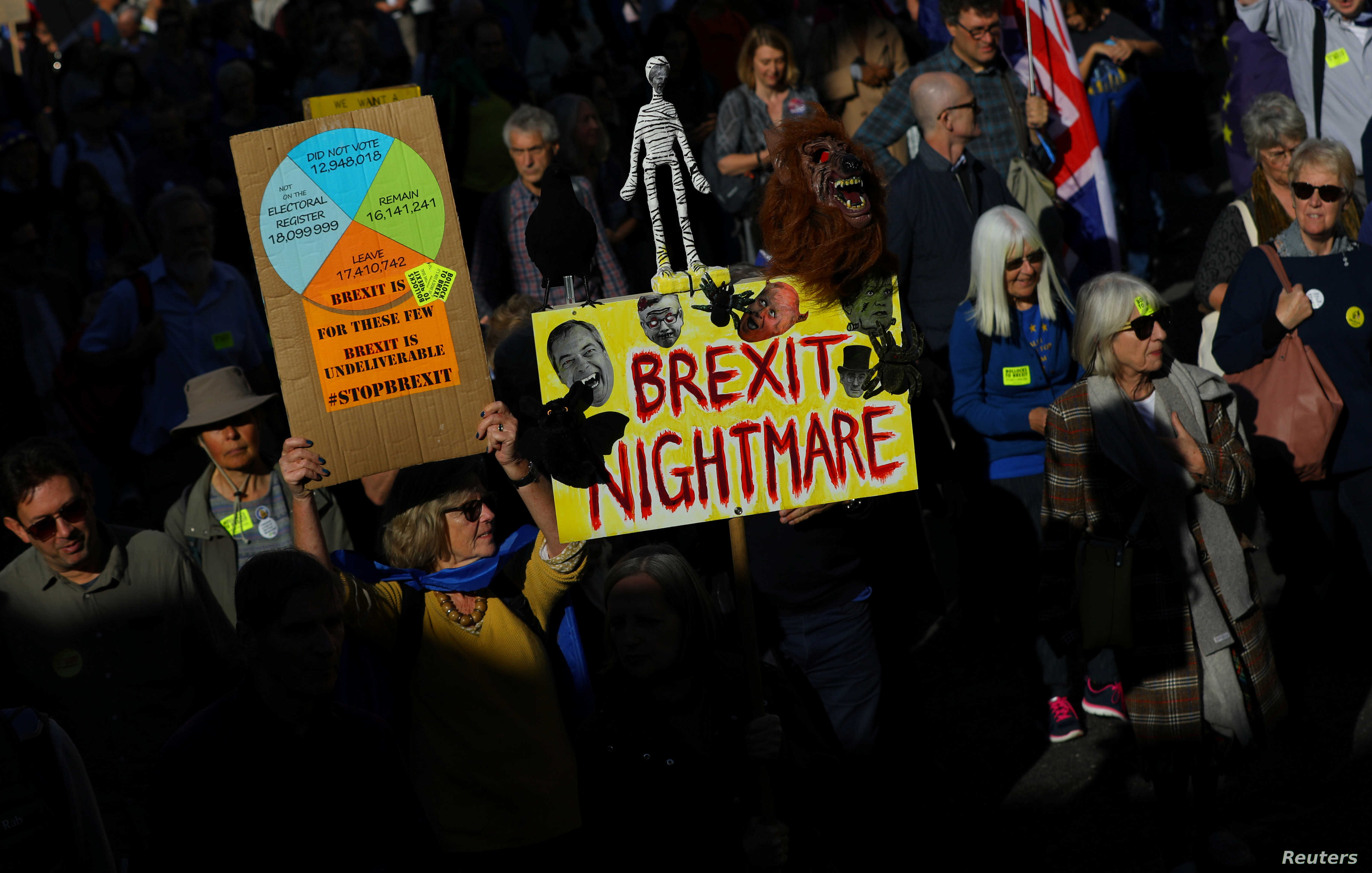 Protesters participating in an anti-Brexit demonstration march through central London, Britain Oct. 20, 2018.