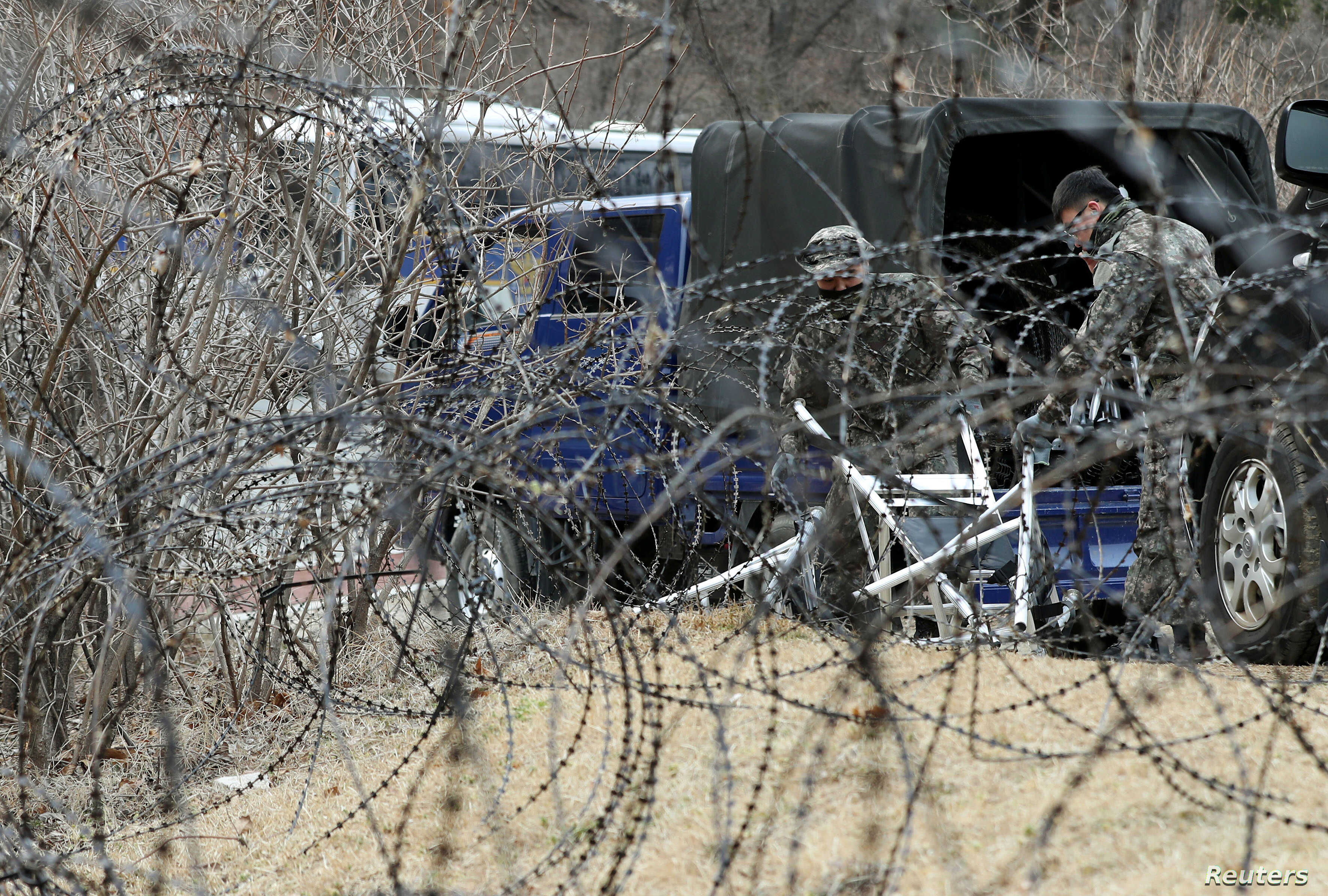A barbed-wire fence is set up around a golf course owned by Lotte, where the U.S. Terminal High Altitude Area Defense (THAAD) system will be deployed, in Seongju, South Korea, March 1, 2017.