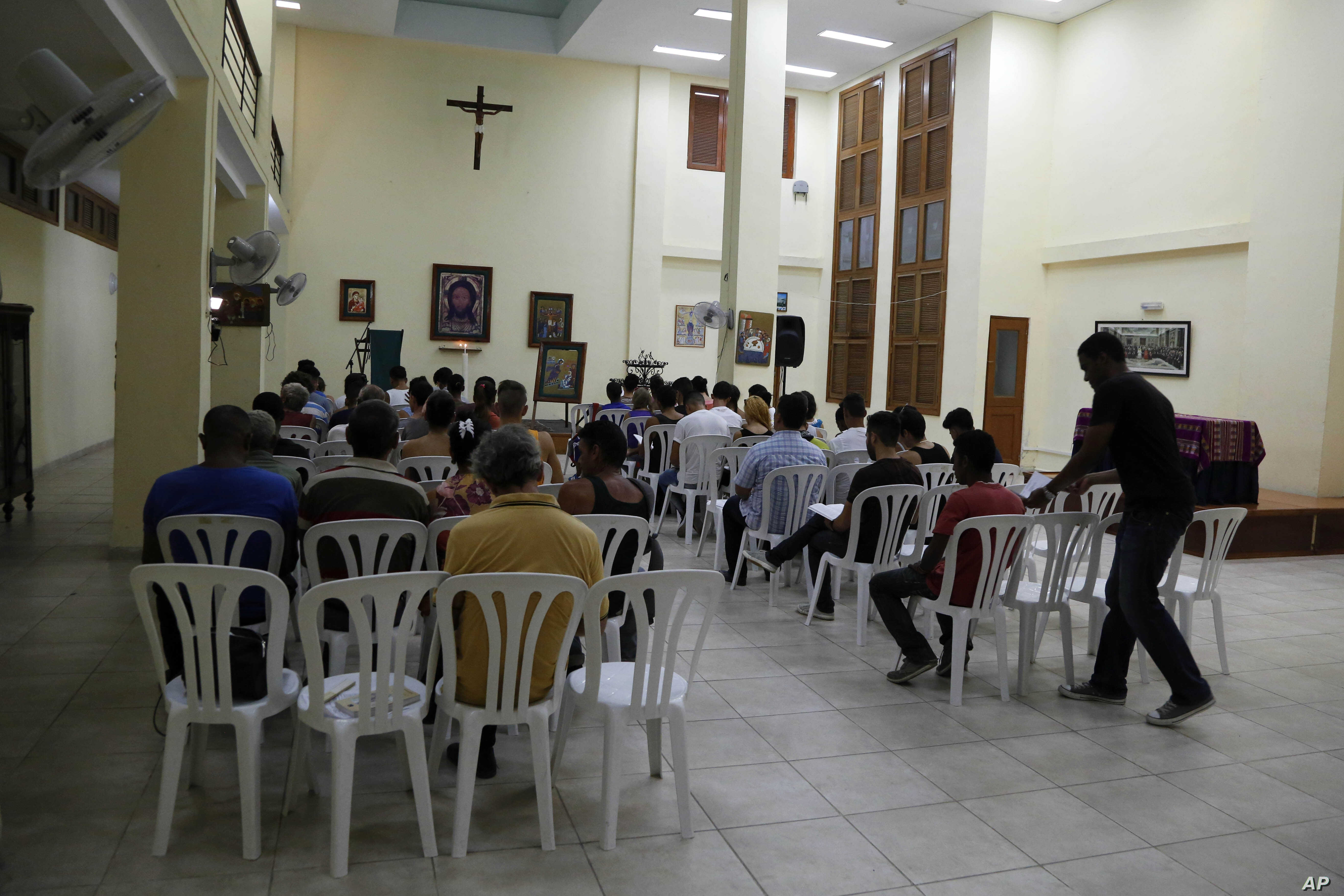In this Aug. 21, 2015, photo, people helped by the San Egidio Church attend a prayer service in Havana, Cuba.