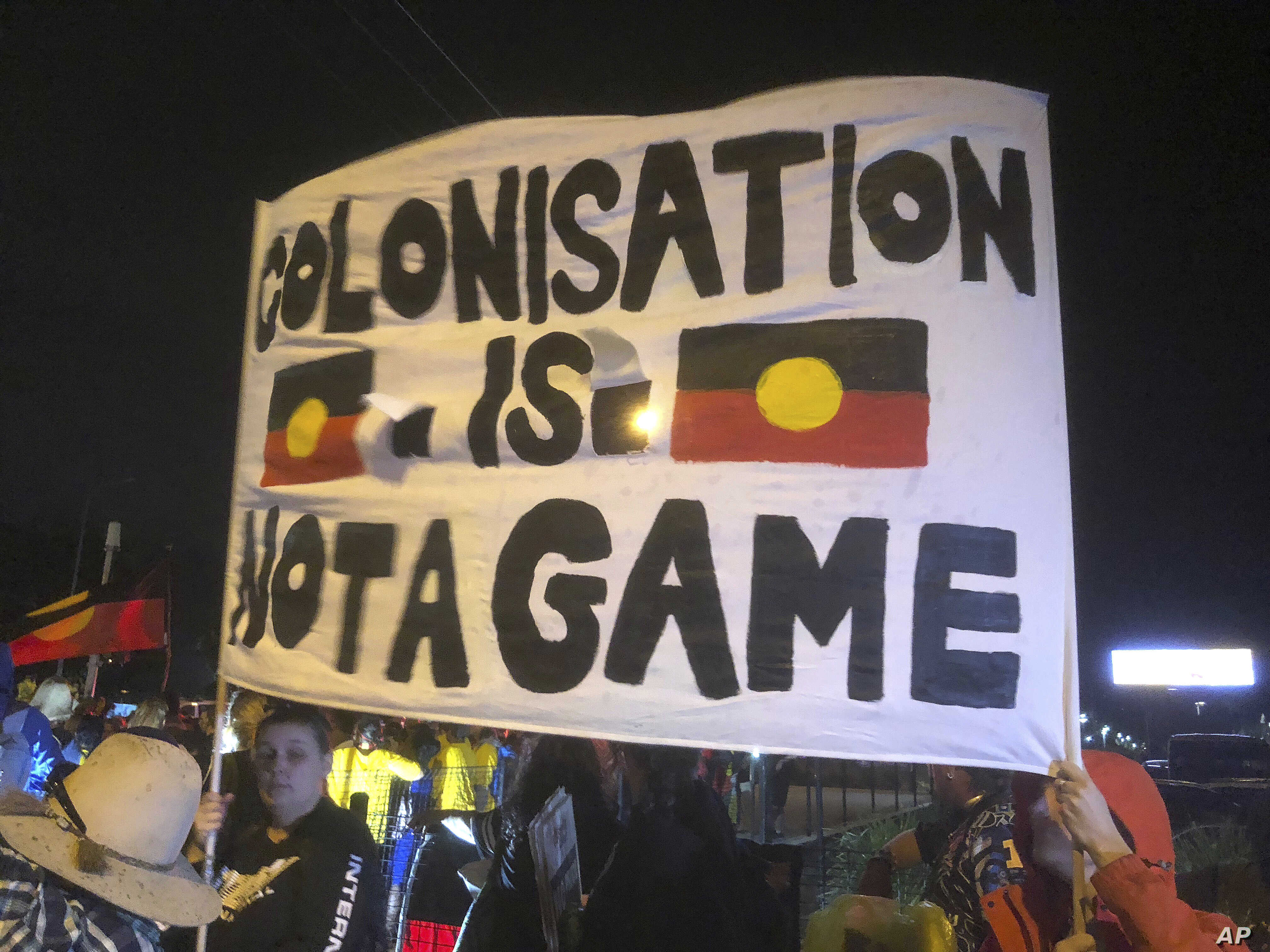 A small group of indigenous protesters blocked a Gold Coast road, bringing a temporary halt to the Queen's baton relay before the opening ceremony for the 2018 Commonwealth Games at Carrara Stadium on the Gold Coast, Australia, April 4, 2018.