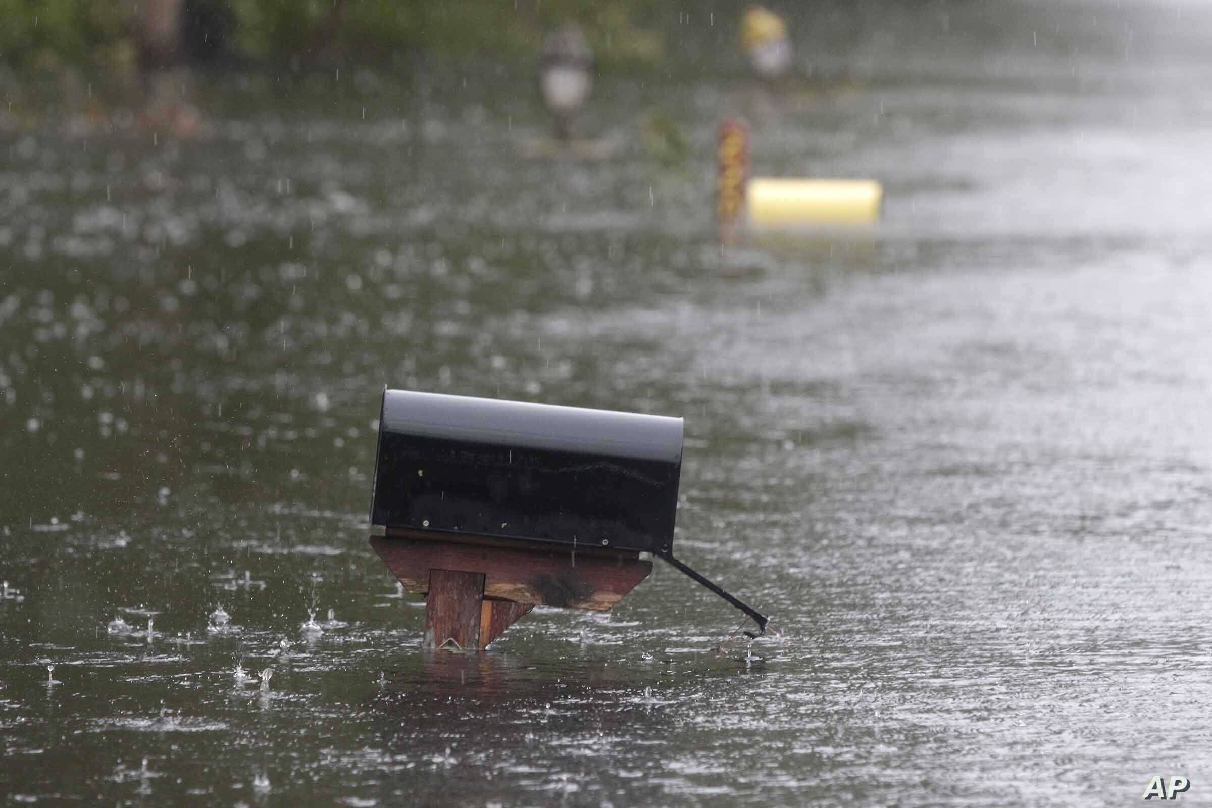 A flooded mailbox on Mill Creek Road is barely above water after Florence hit Newport, N.C., Sept. 15, 2018. A day after blowing ashore, Florence practically parked itself over land all day long and poured on the rain.