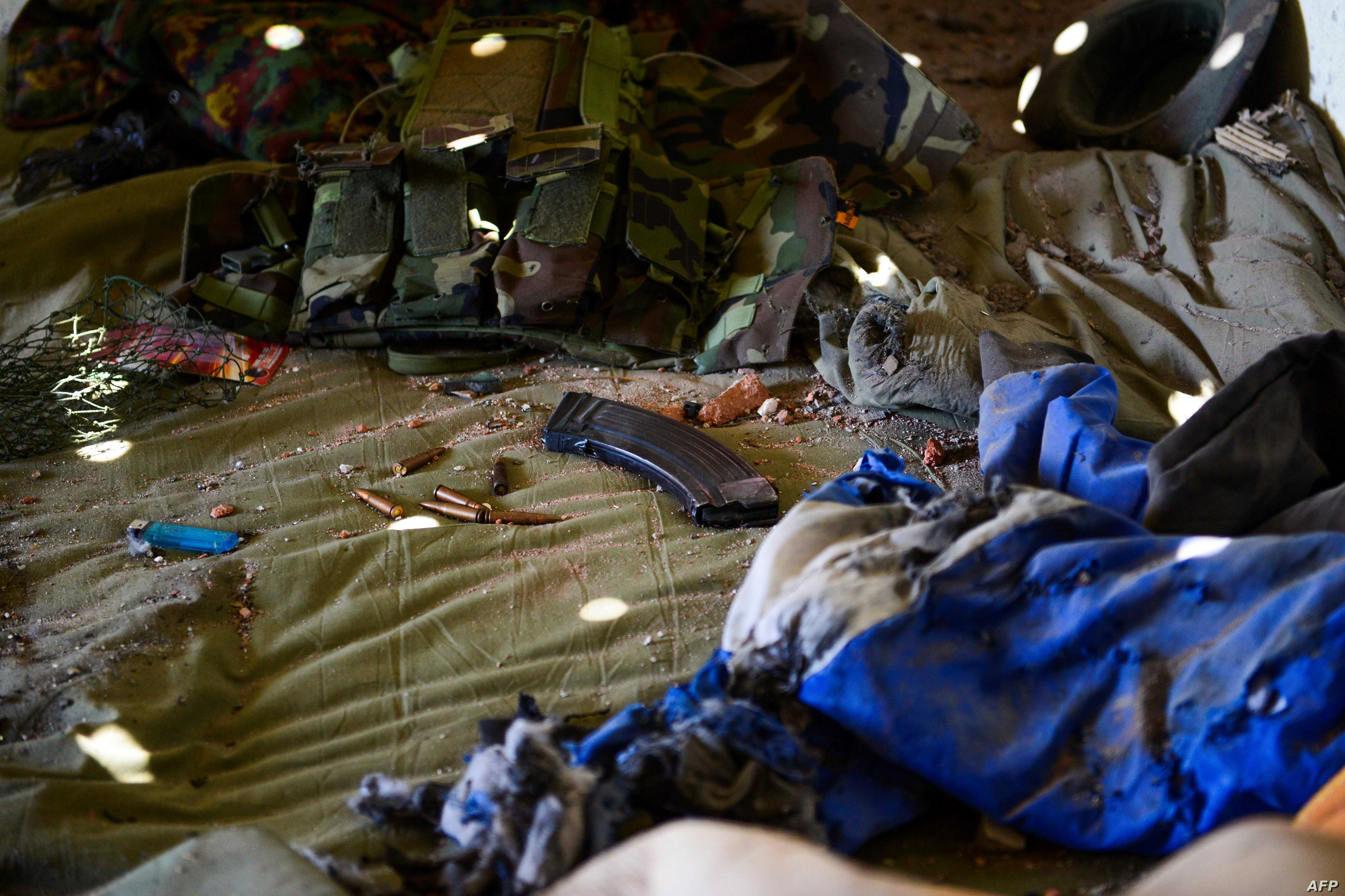 Ammunitions are seen left on a bed inside an army-linked militia post a day after clashes between Myanmar forces and ethnic rebels in Muse, May 13, 2018.