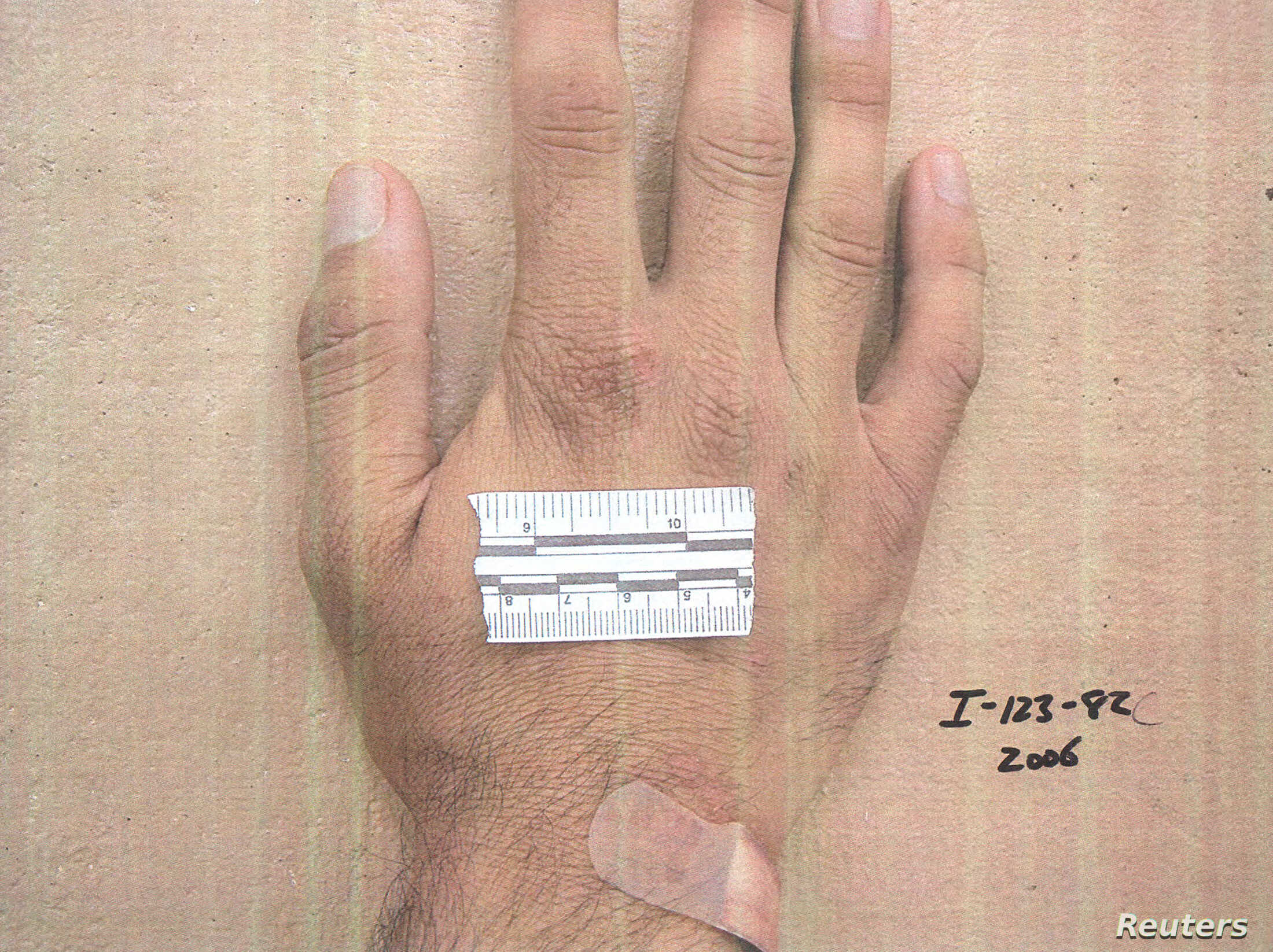 A measurement strip lies on the hand of a detainee in an undated photo from Iraq's Abu Ghraib prison, among 198 images released in a Freedom of Information Act lawsuit against the U.S. Department of Defense in Washington, D.C., Feb. 5, 2016.