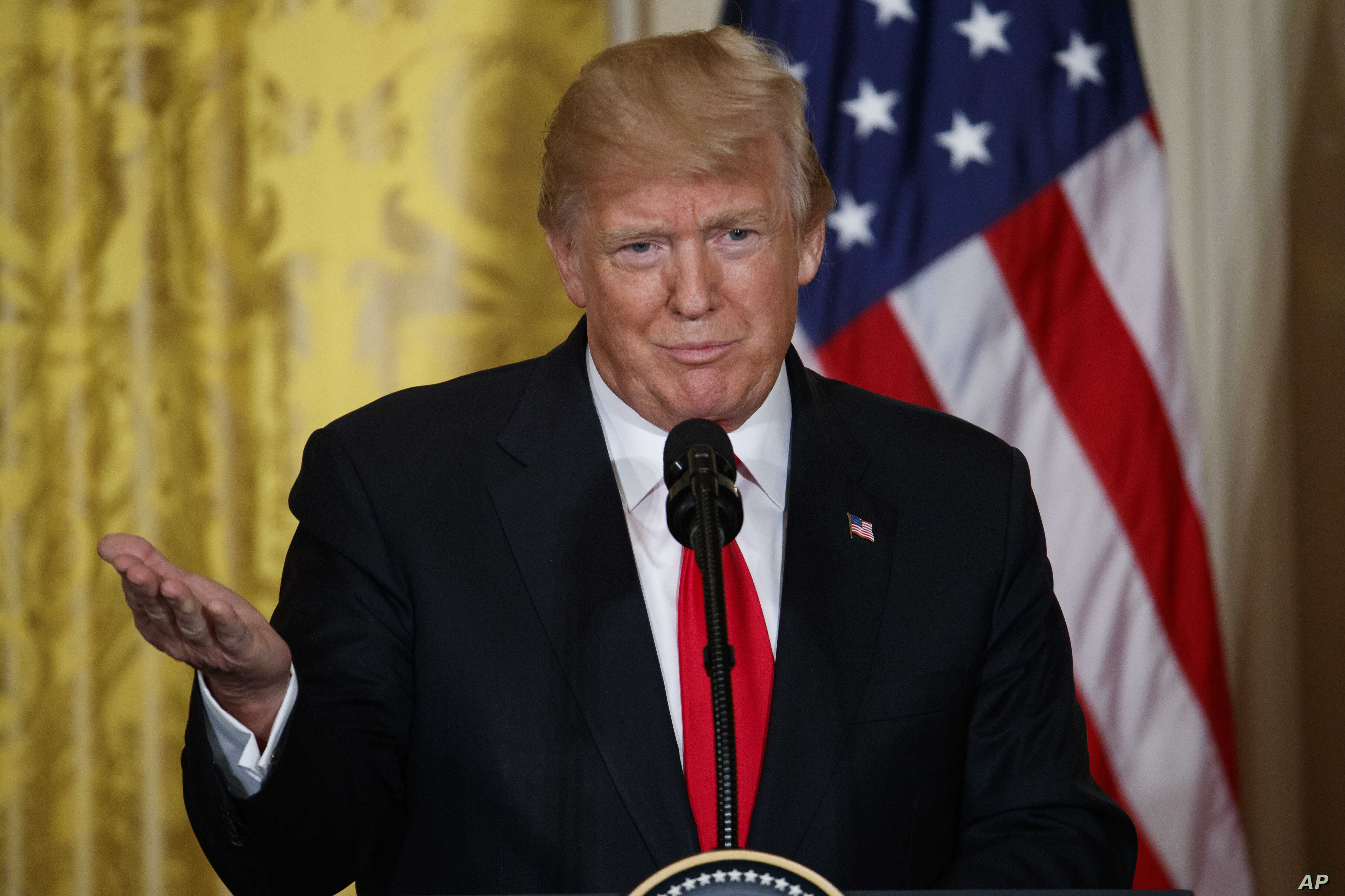 U.S. President Donald Trump speaks during a news conference in the East Room of the White House, Jan. 10, 2018, in Washington.