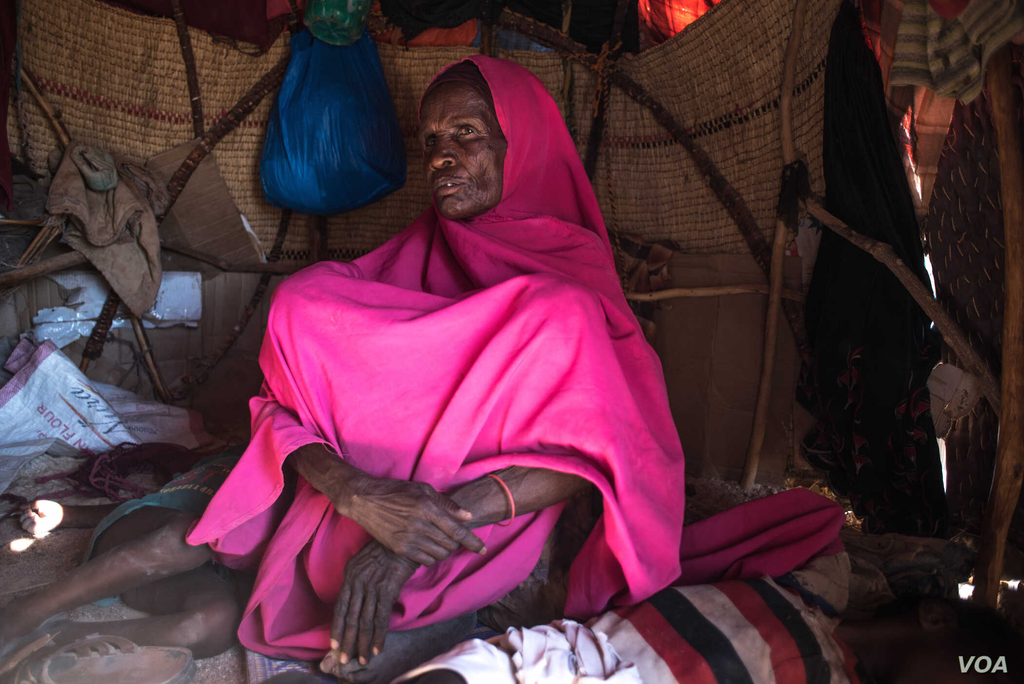 Geelo Ismail Mohamed sits in her makeshift hut after fleeing drought in Somaliland region of Somalia, February 9, 2017. (VOA/Jason Patinkin)