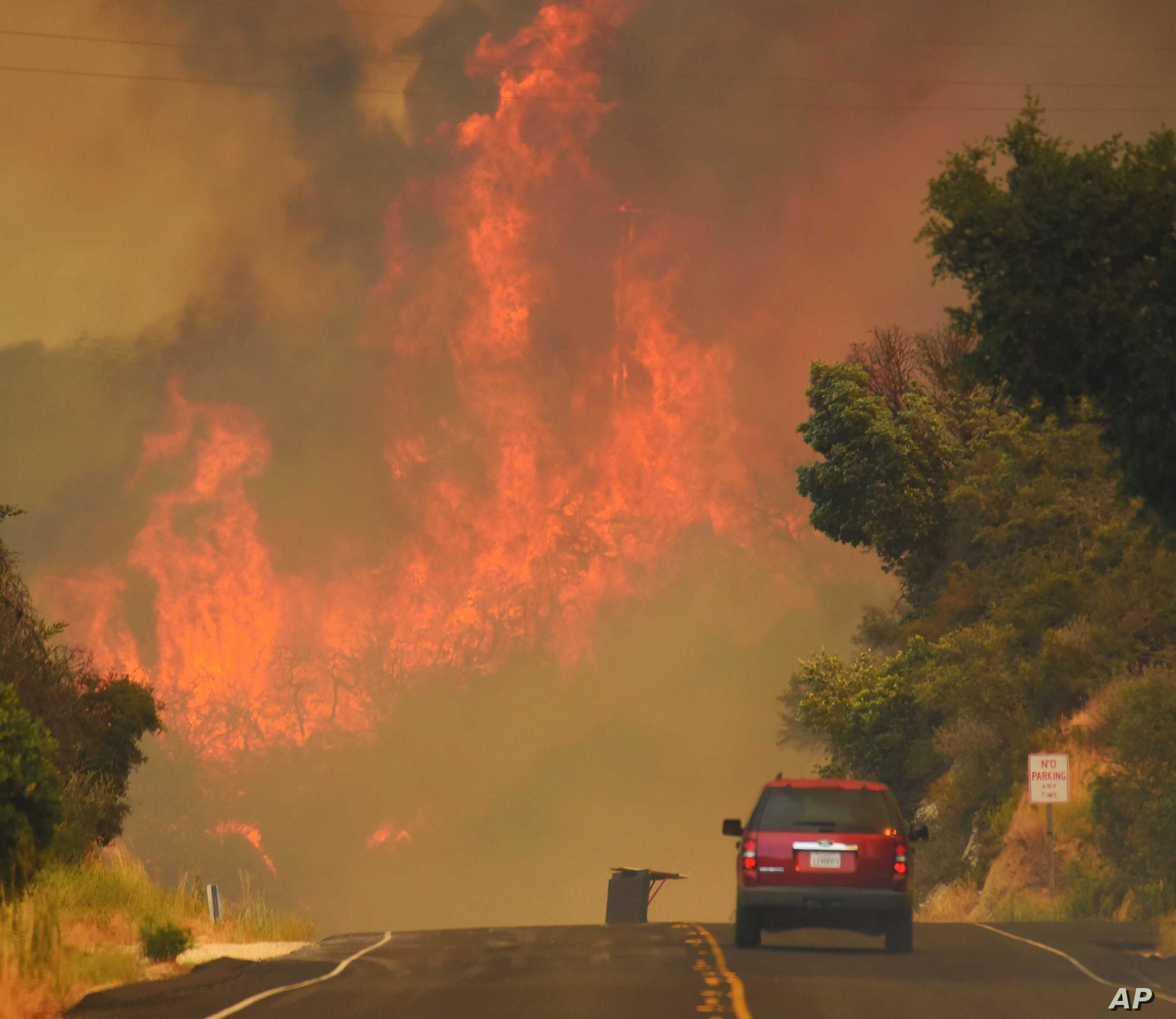 This July 8, 2017, photo released by the Santa Barbara County Fire Department shows a Santa Barbara City Fire vehicle on Highway 154 in the Whittier fire east of Cachuma Lake in Santa Barbara County, California.
