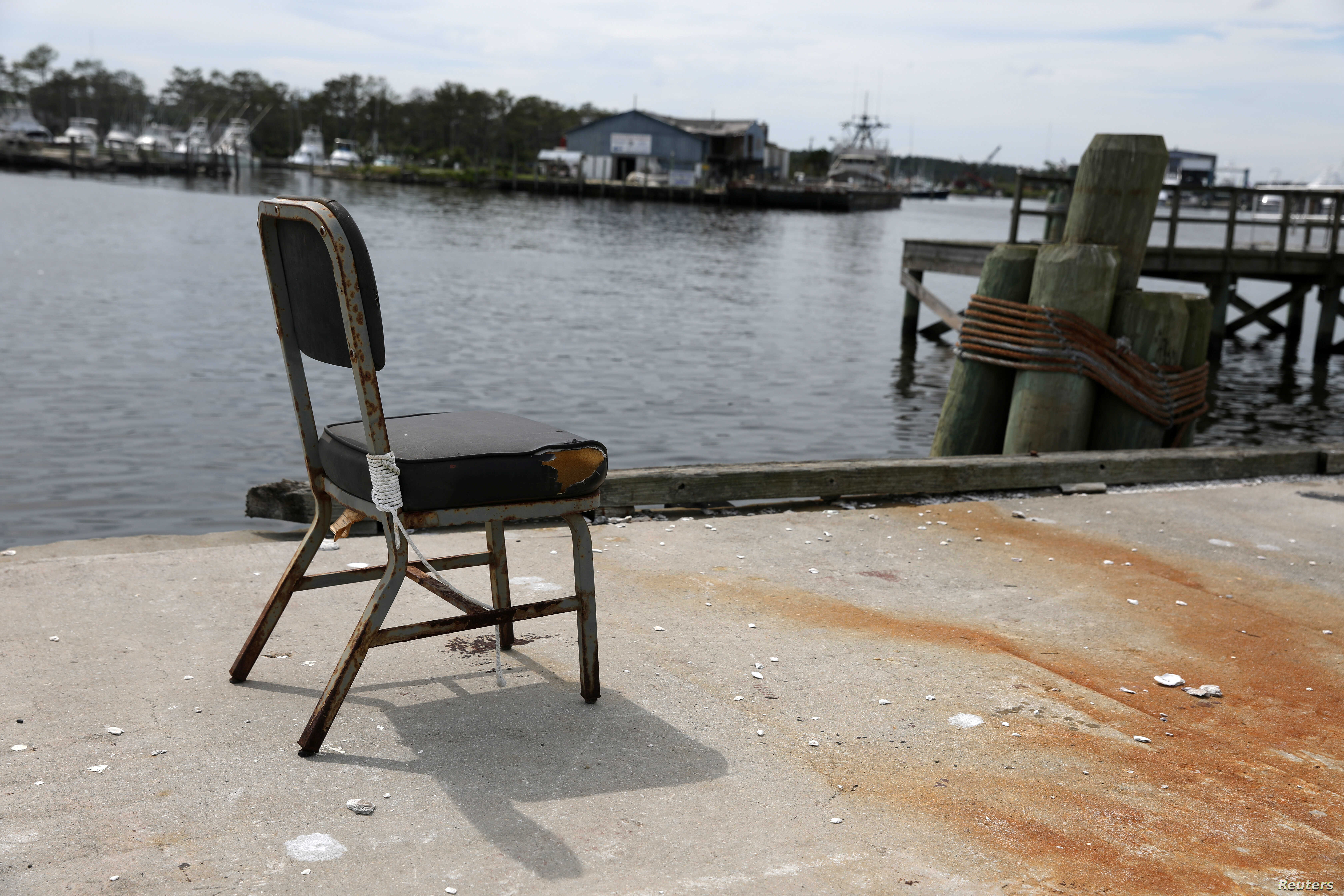 An empty chair sits at a dock in Wanchese, North Carolina, May 30, 2017.