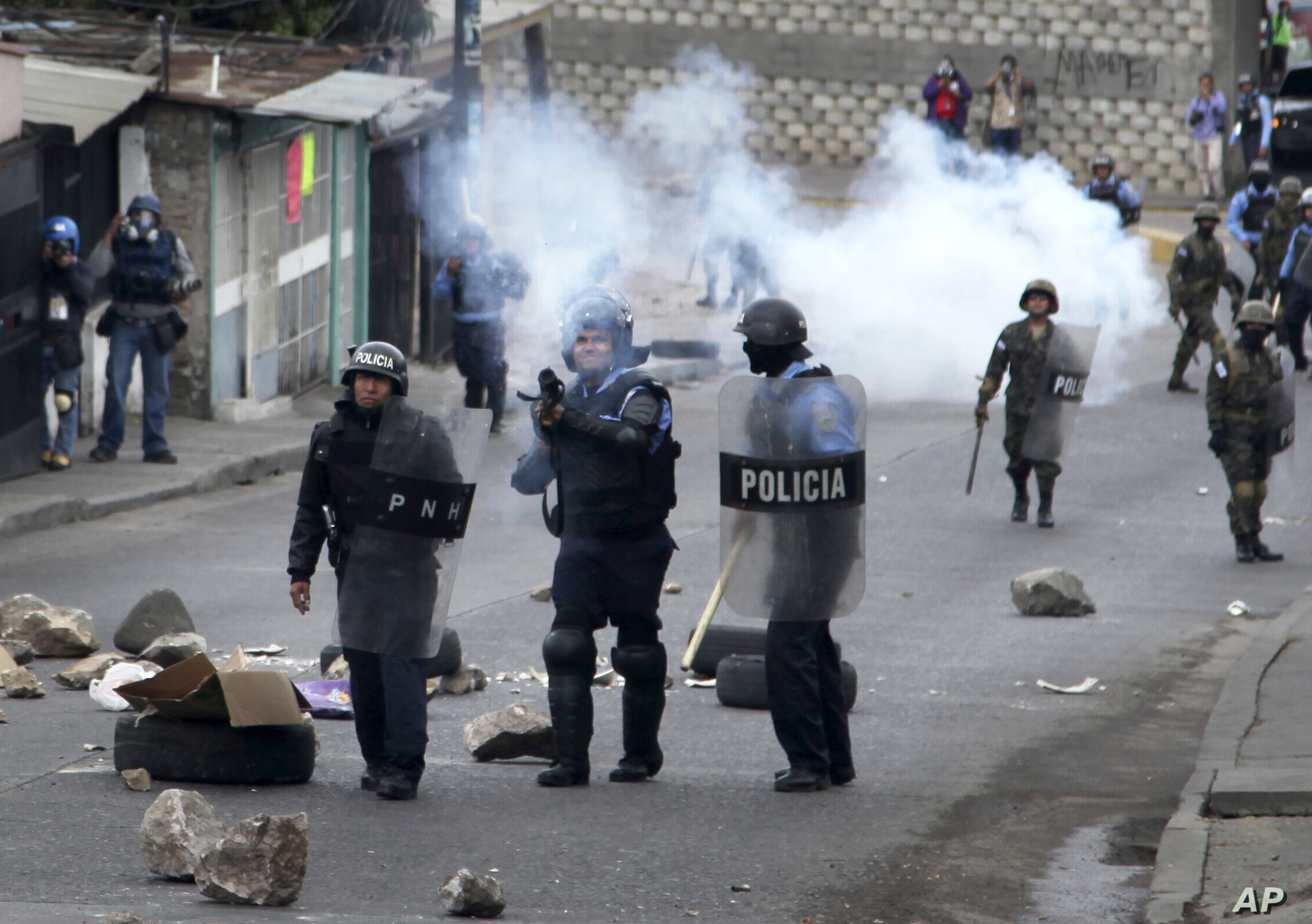 Police fire tear gas at supporters of opposition presidential candidate Salvador Nasralla during clashes in the Policarpo Paz Garcia neighborhood of Tegucigalpa, Honduras, Jan. 20, 2018.
