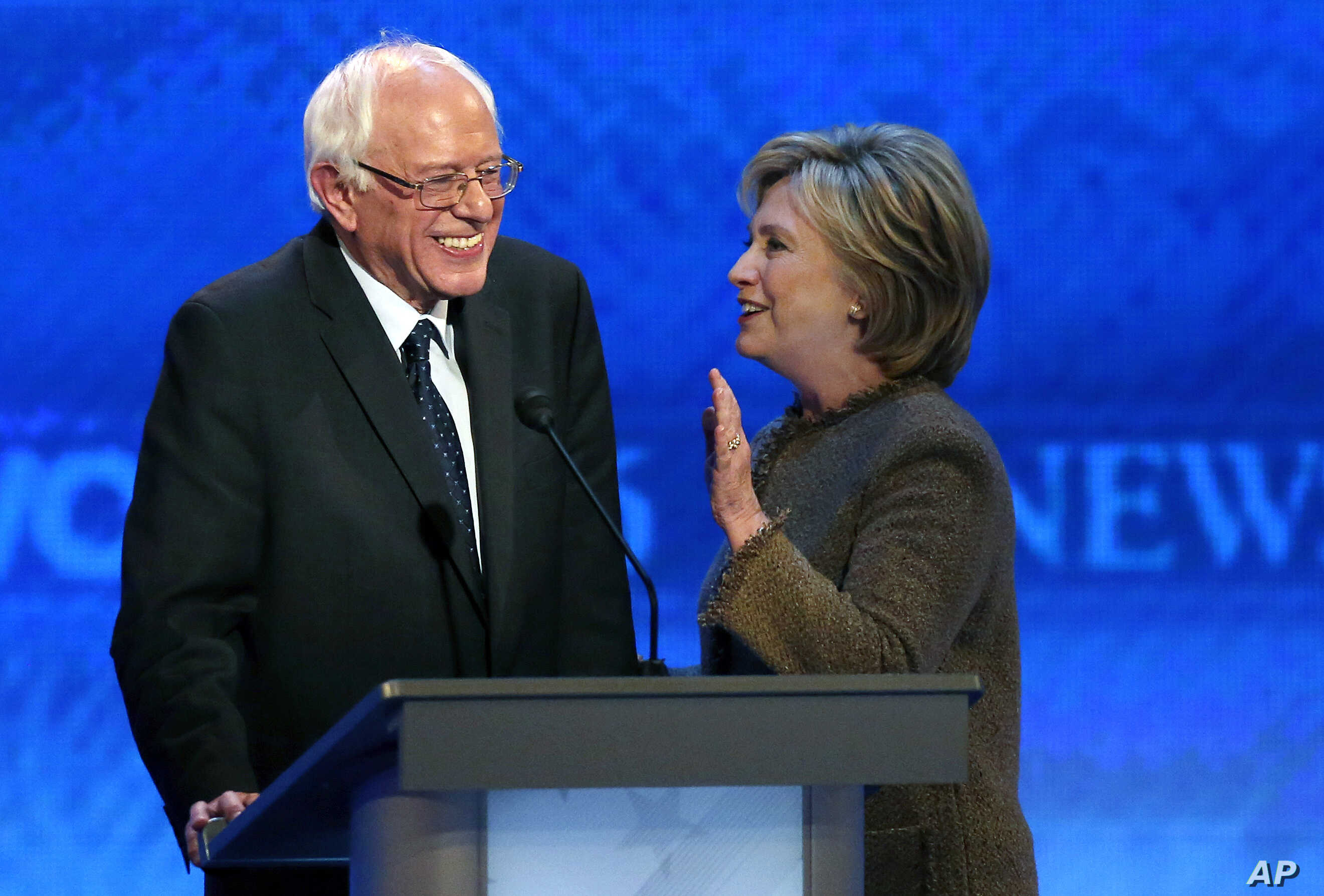 Hillary Clinton, right, speaks to Bernie Sanders during a break at the Democratic presidential primary debate, at Saint Anselm College in Manchester, N.H., Dec. 19, 2015.