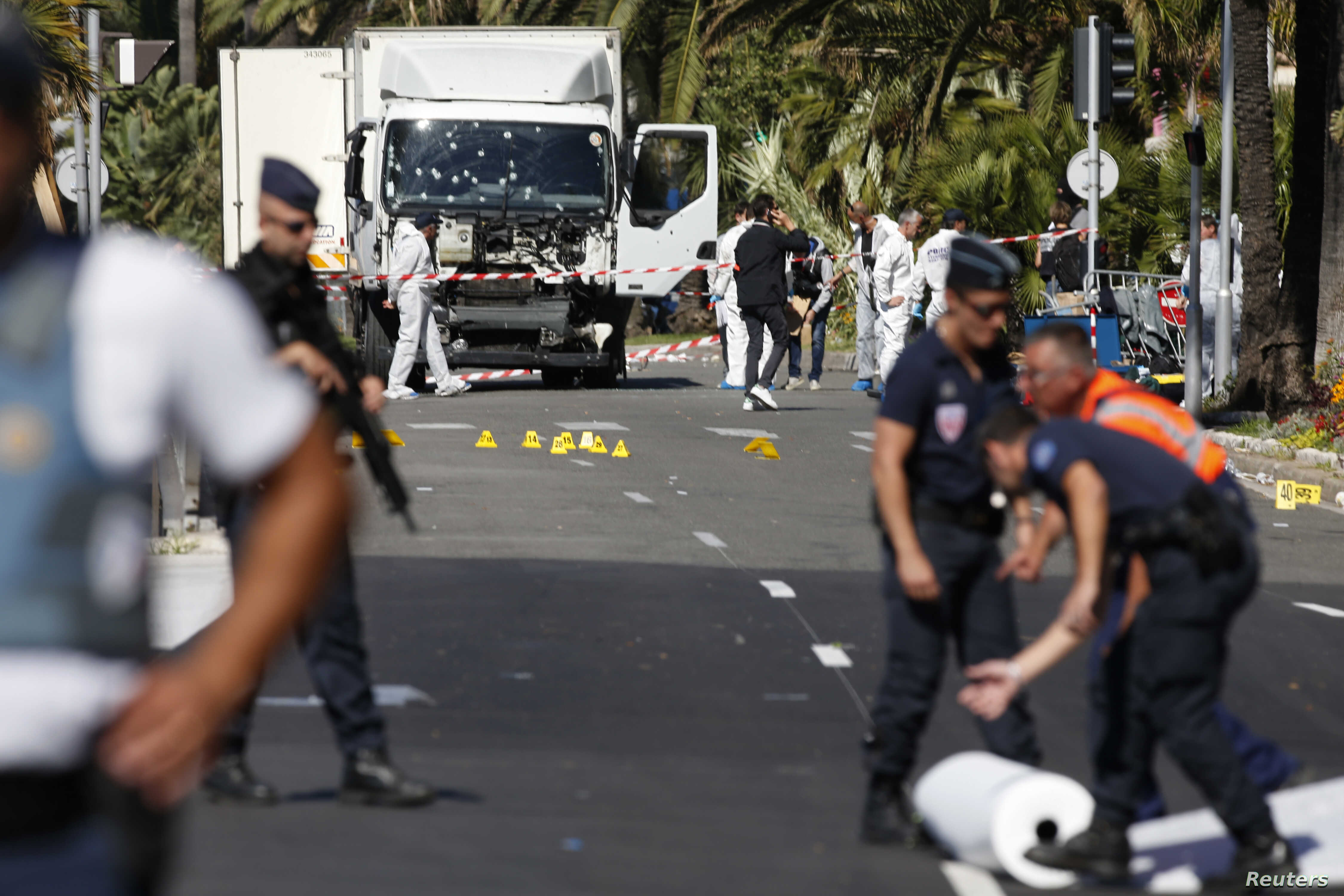 French police secure the area as the investigation continues at the scene near the heavy truck that ran into a crowd at high speed killing scores who were celebrating the Bastille Day July 14 national holiday on the Promenade des Anglais in Nice, Fra...