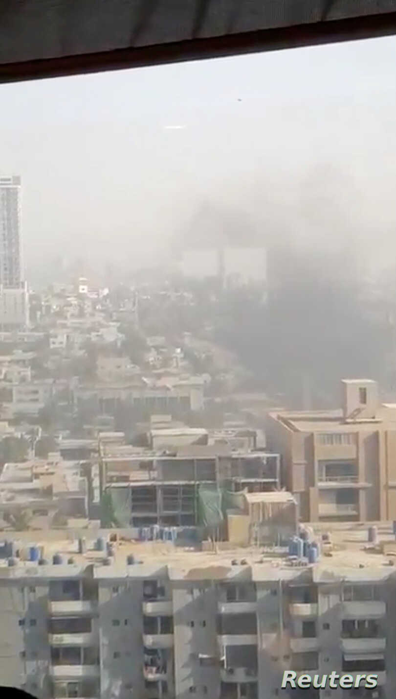 Smoke rises from the Chinese consulate after an attack by gunmen in Karachi, Pakistan, Nov. 23, 2018, in this still image taken from a video obtained from social media.