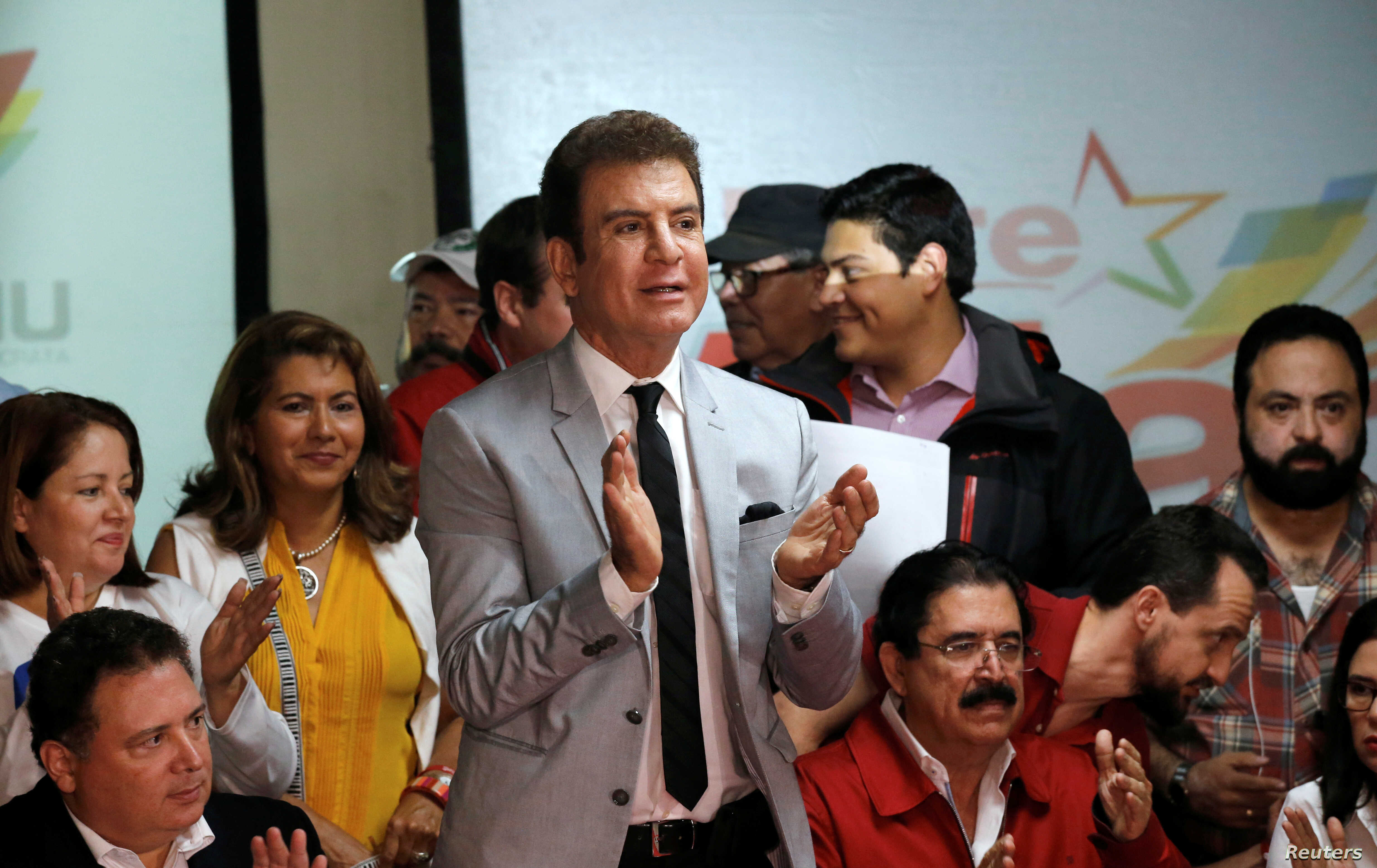 Salvador Nasralla, presidential candidate of the Opposition Alliance Against the Dictatorship applauds next to Former Honduran President Manuel Zelaya as they attend a news conference in Tegucigalpa, Honduras, Dec. 4, 2017.