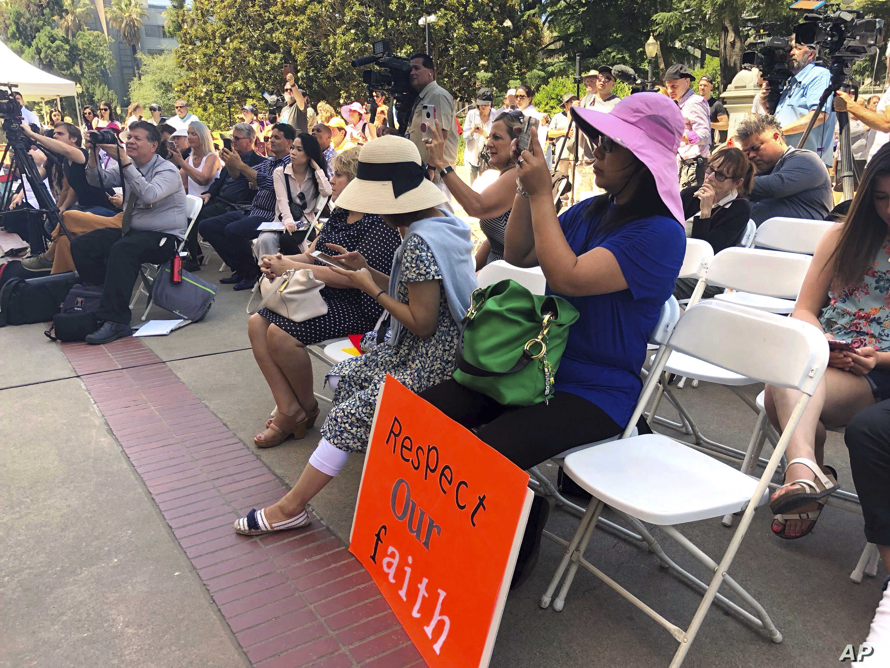 FILE - Opponents of a California bill to declare gay conversion therapy a fraudulent practice gather at a rally outside the Capitol as the Senate holds a hearing on the matter inside in Sacramento, June 12, 2018. Opponents said the legislation could ...