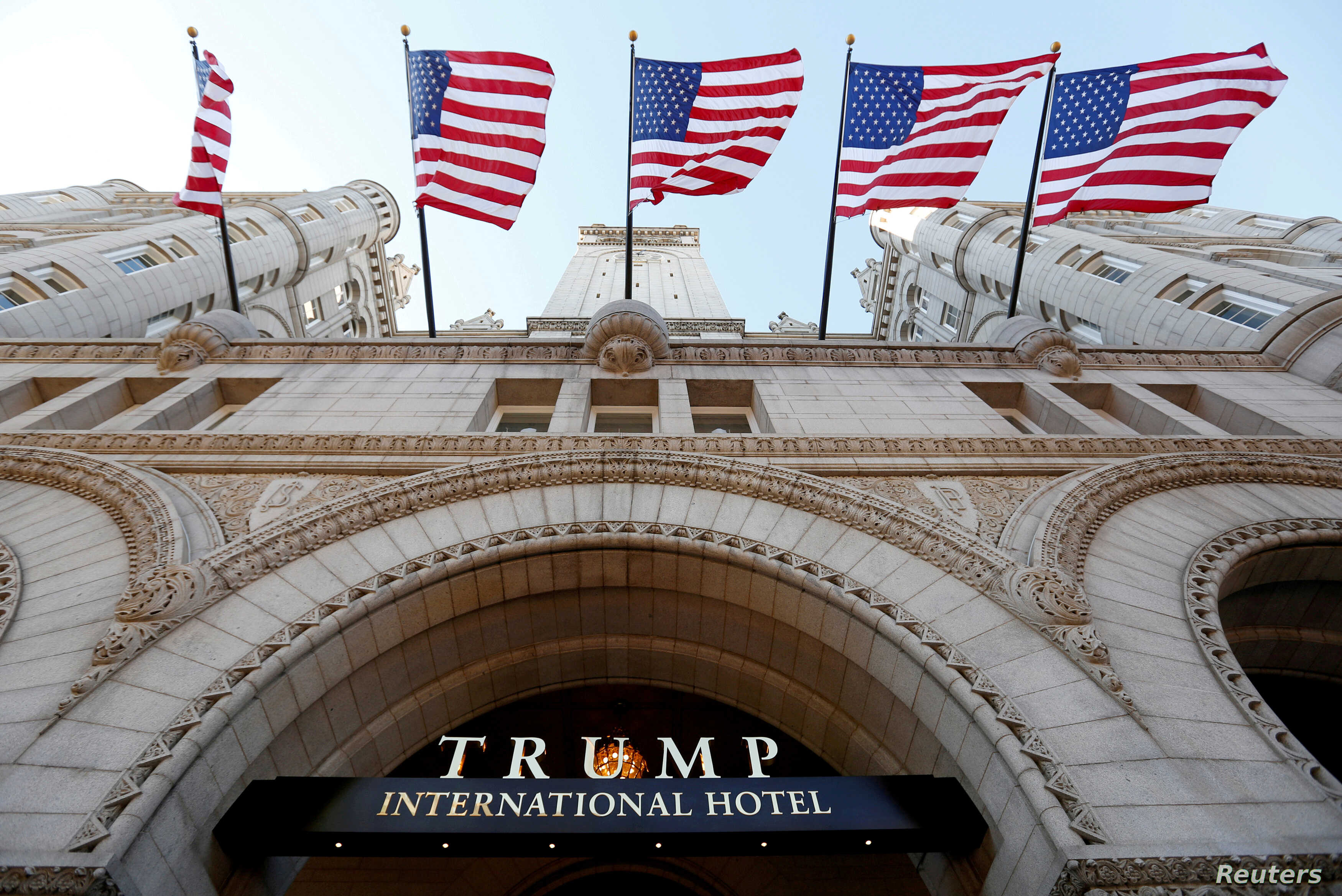 FILE - Flags fly above the entrance to the new Trump International Hotel on its opening day in Washington, DC, U.S. on Sept. 12, 2016.