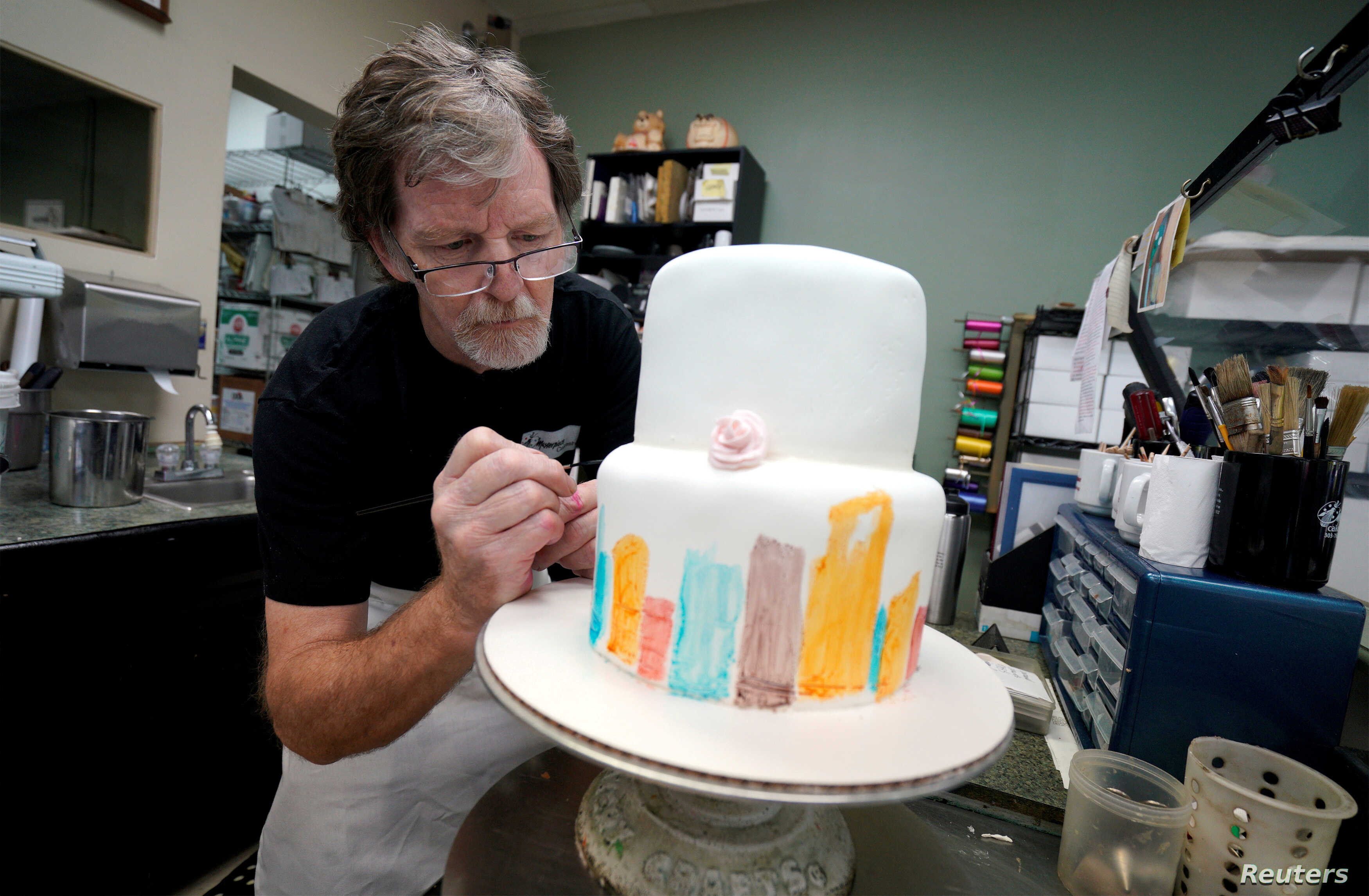Baker, Jack Phillips, decorates a cake in his Masterpiece Cakeshop in Lakewood, Colorado, Sept. 21, 2017.