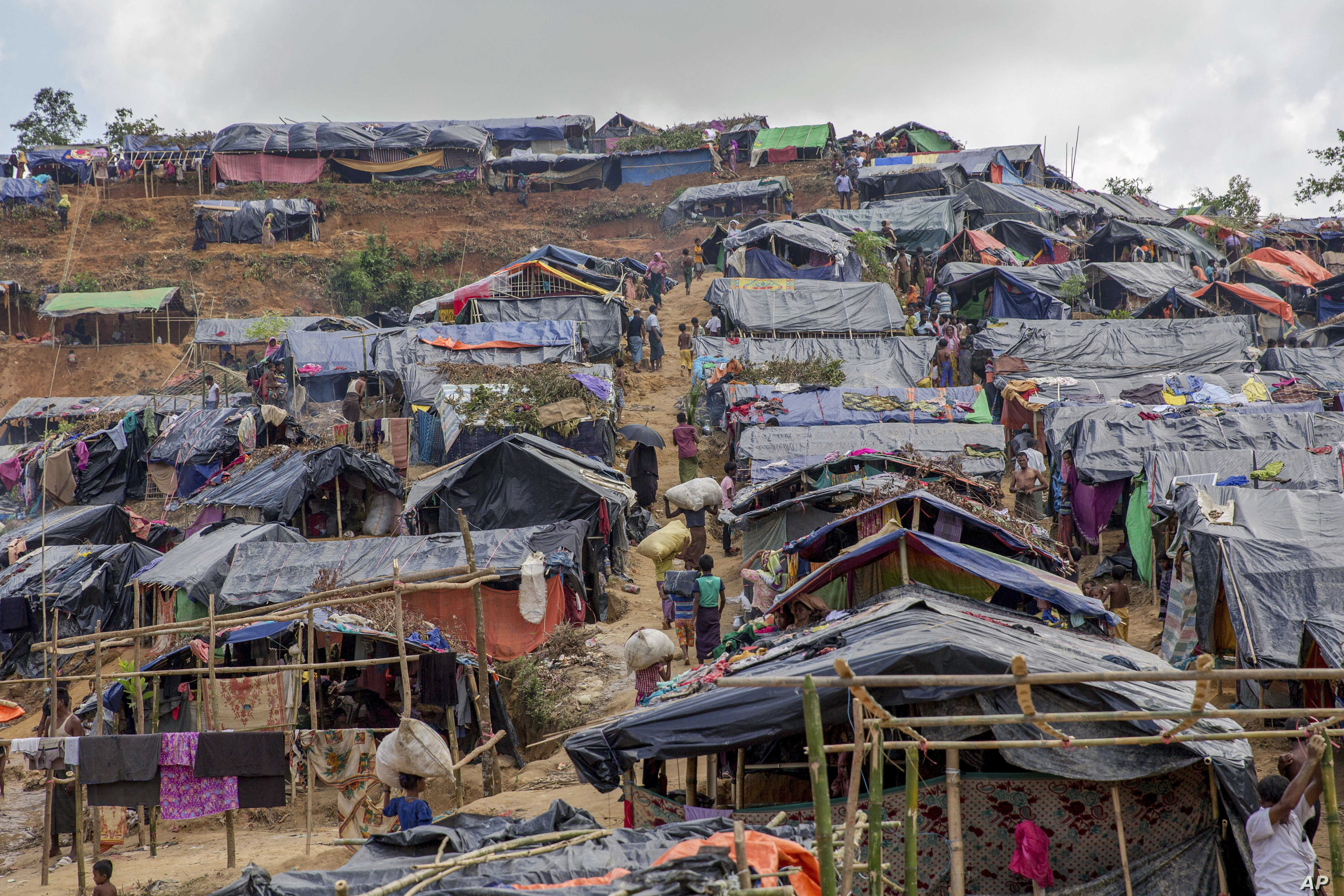 Newly set up tents cover a hillock at a refugee camp for Rohingya Muslims, who crossed over from Myanmar into Bangladesh, in Taiy Khali, Bangladesh, Friday, Sept. 22, 2017.