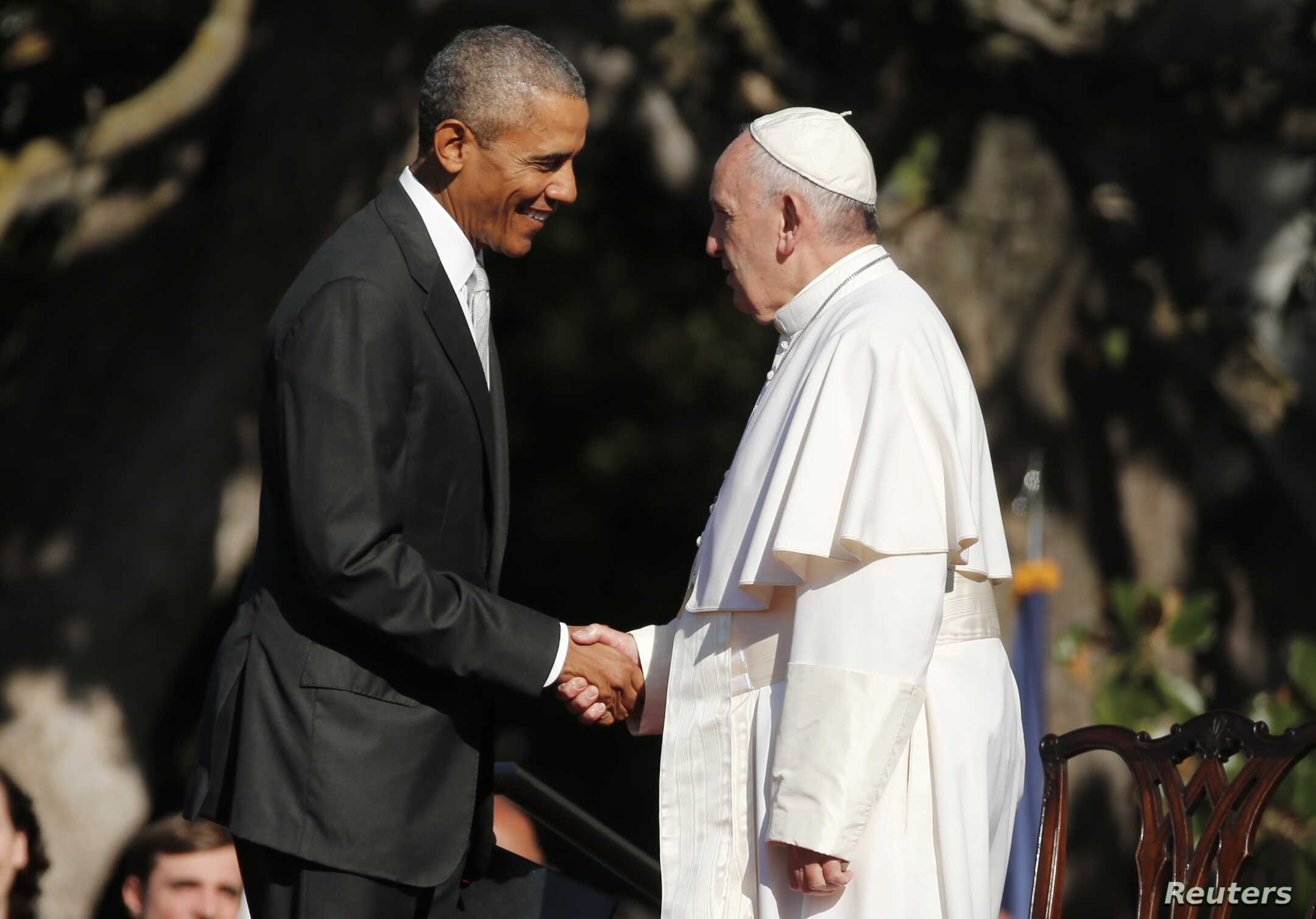 U.S. President Barack Obama, left, greets Pope Francis upon his arrival at the White House in Washington, Sept. 23, 2015.