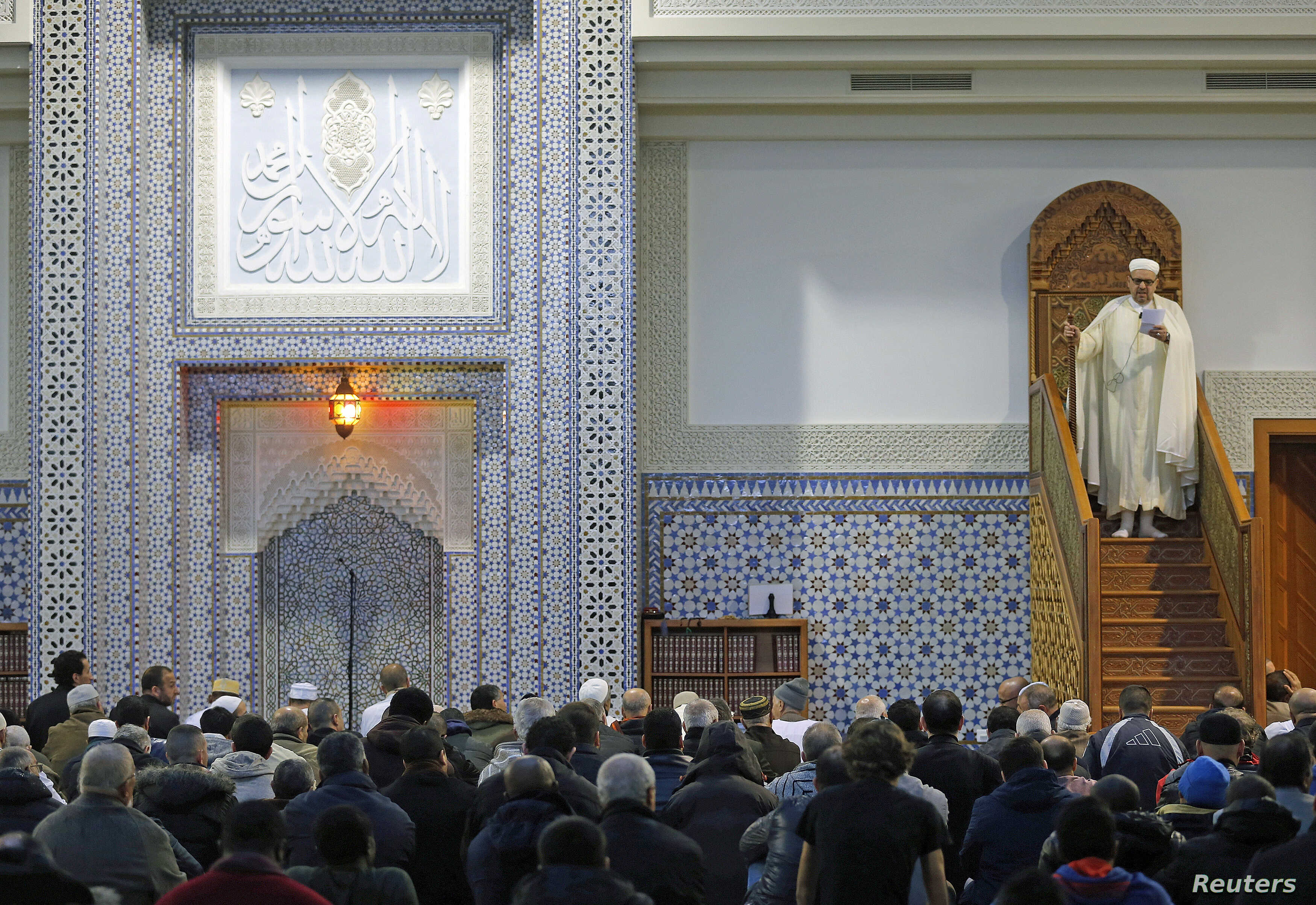 Members of the Muslim community attend the Friday prayer at Strasbourg Grand Mosque, one week after the deadly attacks in Paris, France, Nov. 20, 2015.