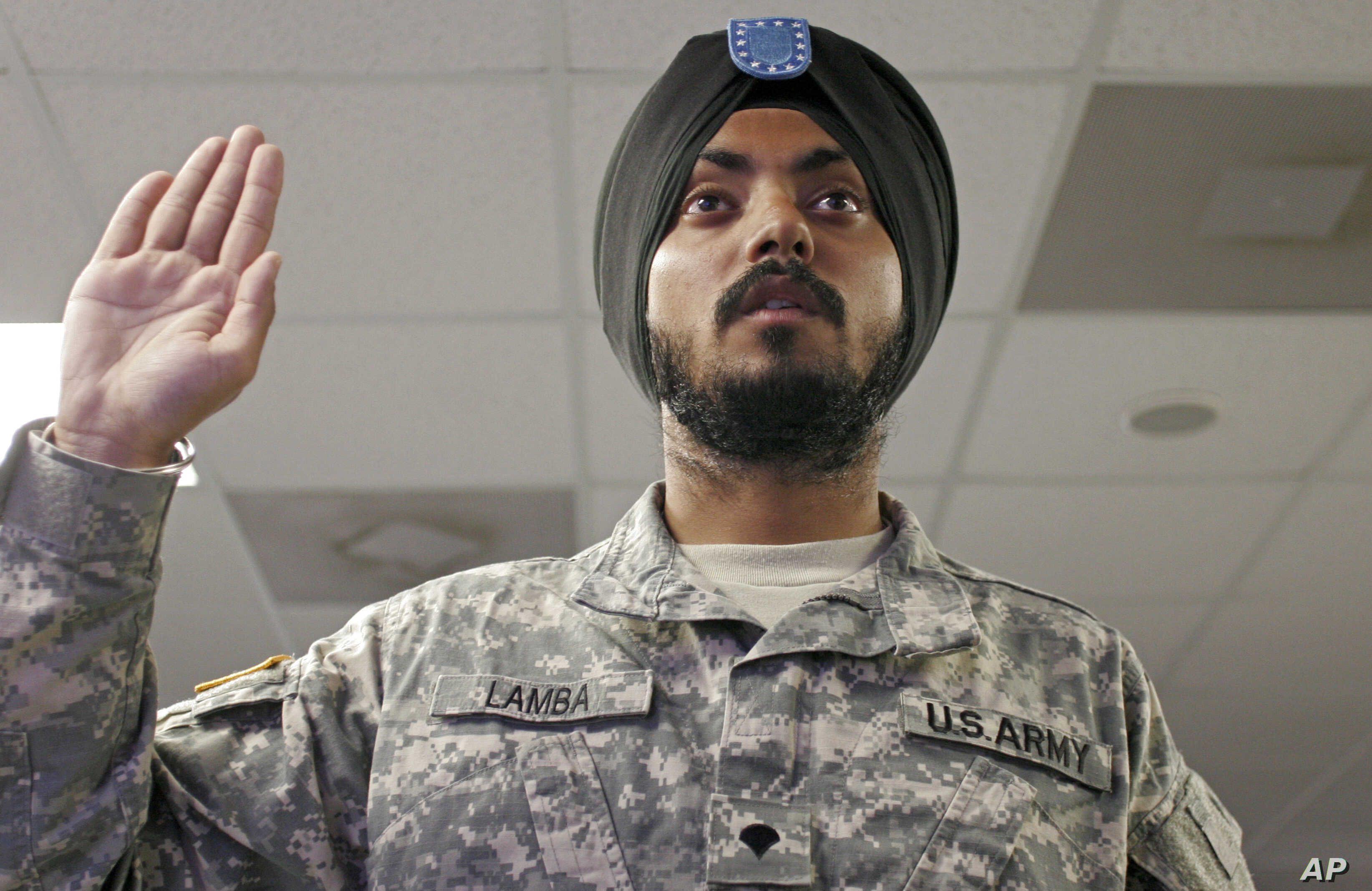 FILE - U.S. Army Spc. Simran Lamba takes the oath of citizenship to become a naturalized citizen before his graduation from basic training at Fort Jackson, South Carolina, Nov. 10, 2010.