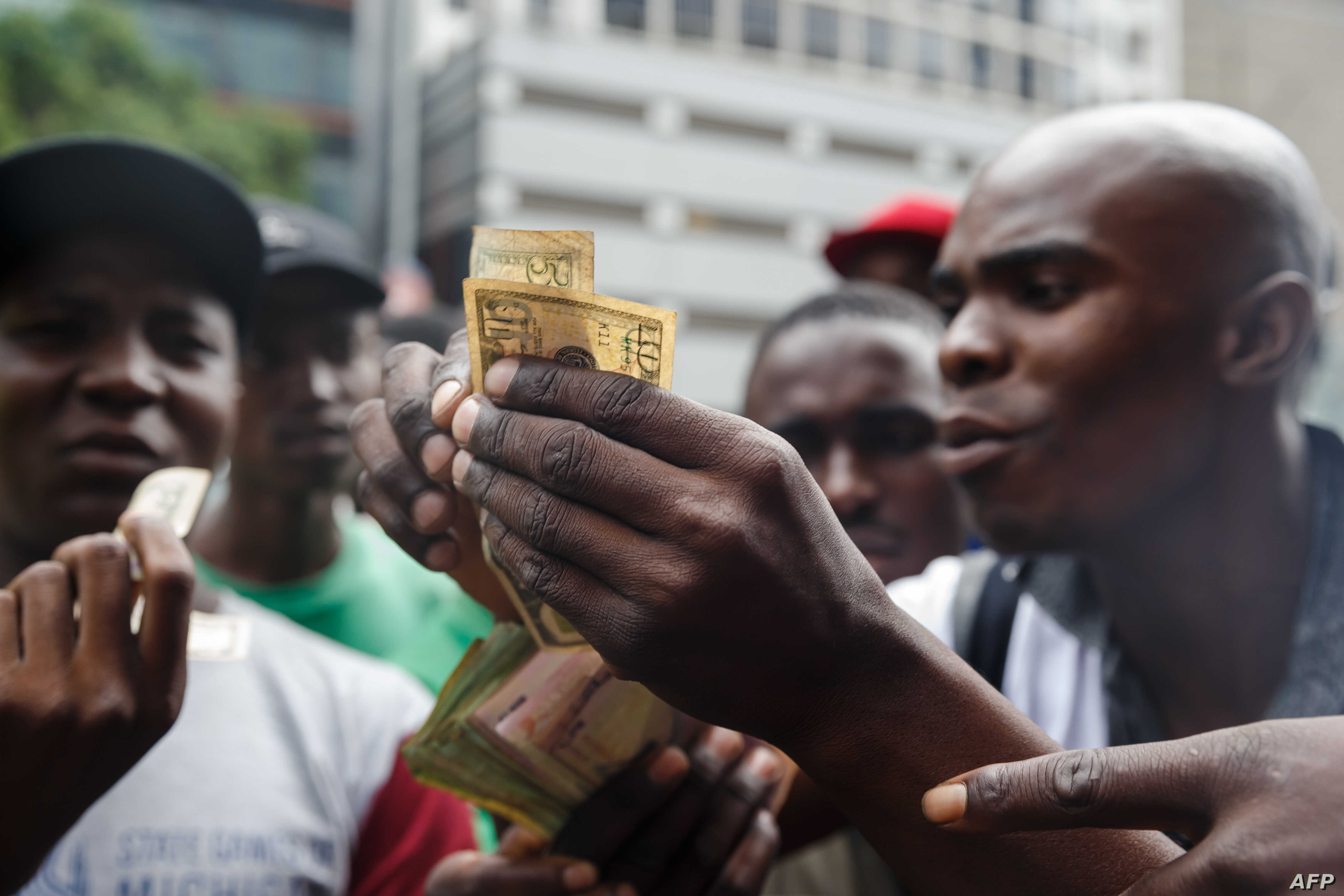 Public transport drivers complain about having to pay for fuel in U.S. dollars at a fuel station, Jan. 11, 2019, in Harare. Motorists are spending nights waiting in long queues for petrol and diesel as the country is experiencing crippling fuel short...