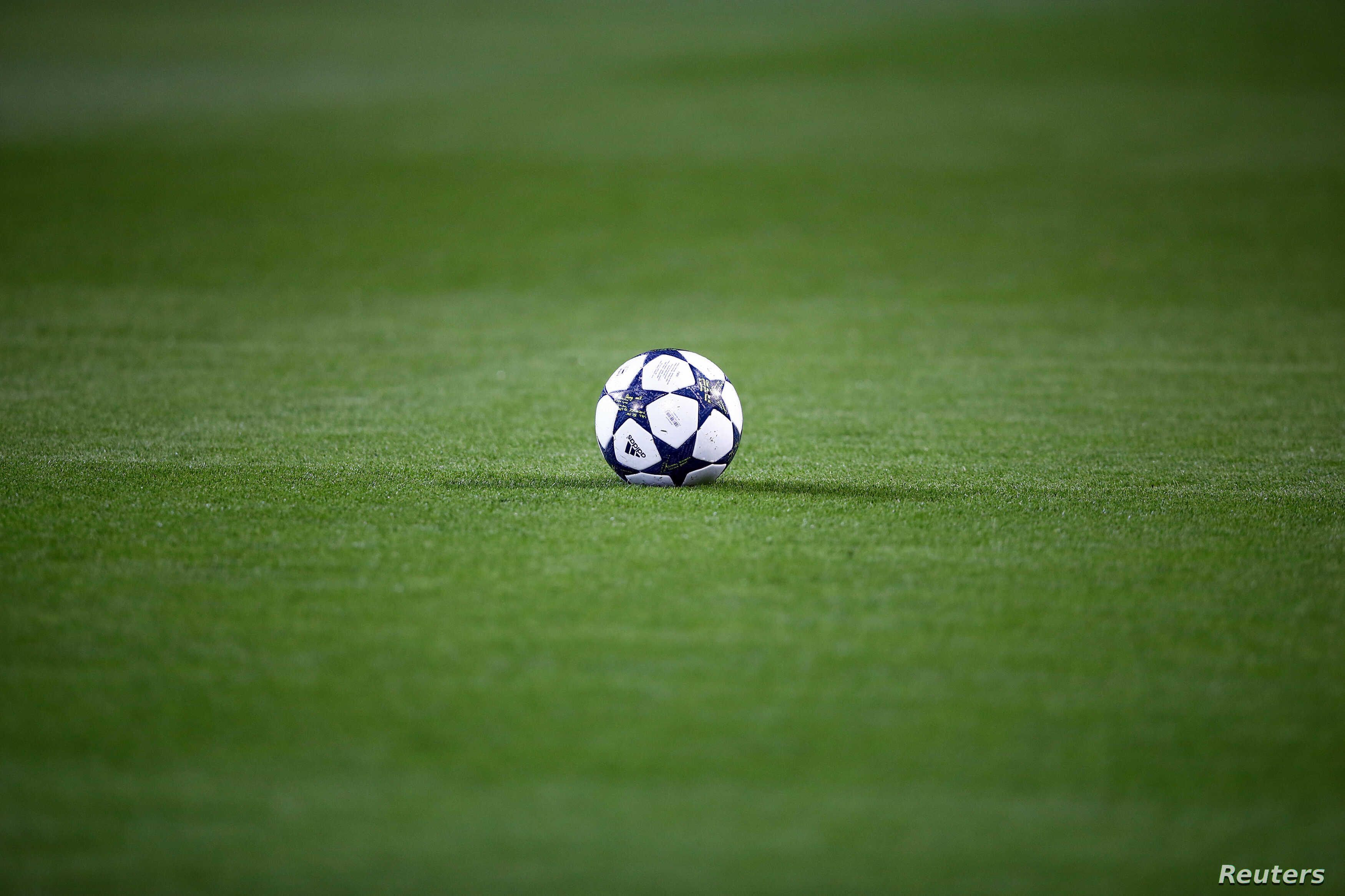 FILE - A soccer ball is seen on the pitch before kick off between Borussia Dortmund and Sporting Lisbon, Feb. 11, 2016.