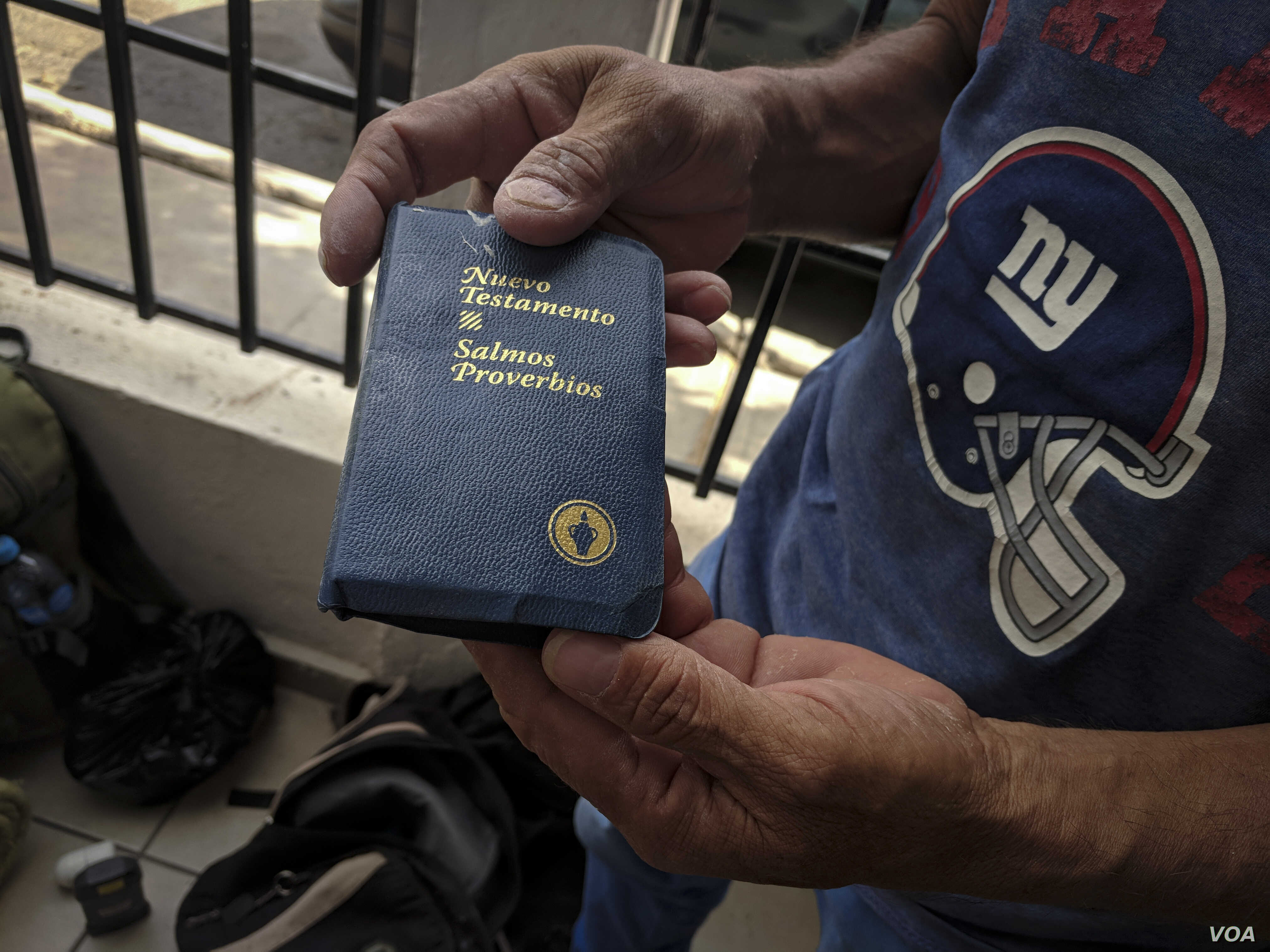 New Testament - Mario Hernandez holds up a copy of the New Testament, one of the few items he carried with him on his journey north, from Chiquimulilla, Guatemala, to Mexicali, Mexico. (R. Taylor/VOA)
