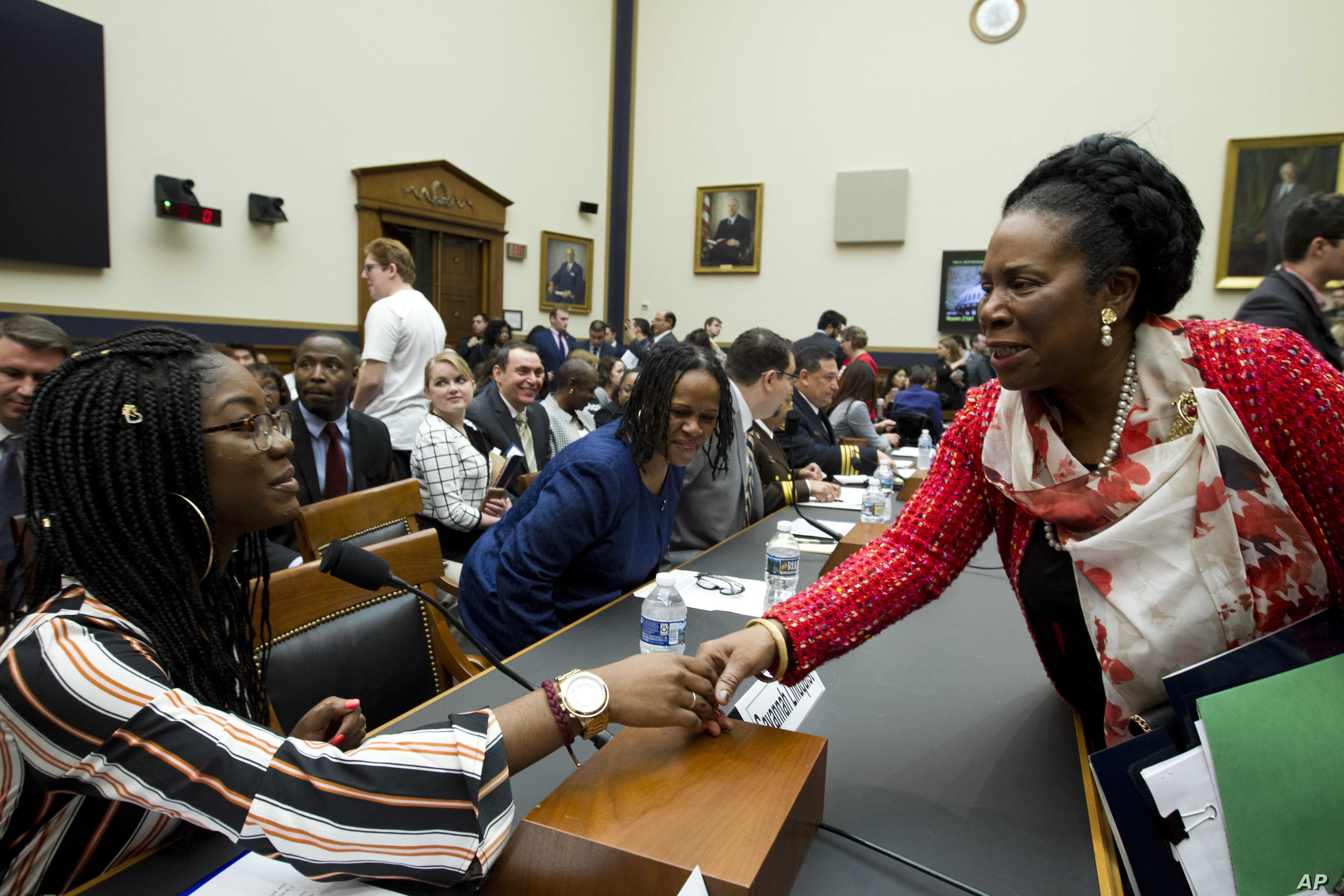 Rep. Sheila Jackson Lee D-Texas, shake hands with Marjory Stoneman Douglas High School senior Aalayah Eastmond, during a House Judiciary Committee hearing on gun violence, at Capitol Hill in Washington,  Feb. 6, 2019.