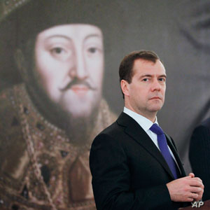 Russian President Dmitry Medvedev stands in front of a picture of Russian Czar Mikhail at the opening ceremony of the exhibition 'Czar's court under the Romanovs' scepter' from the Kremlin museums, in Prague, Czech Republic, Dec. 8, 2011.