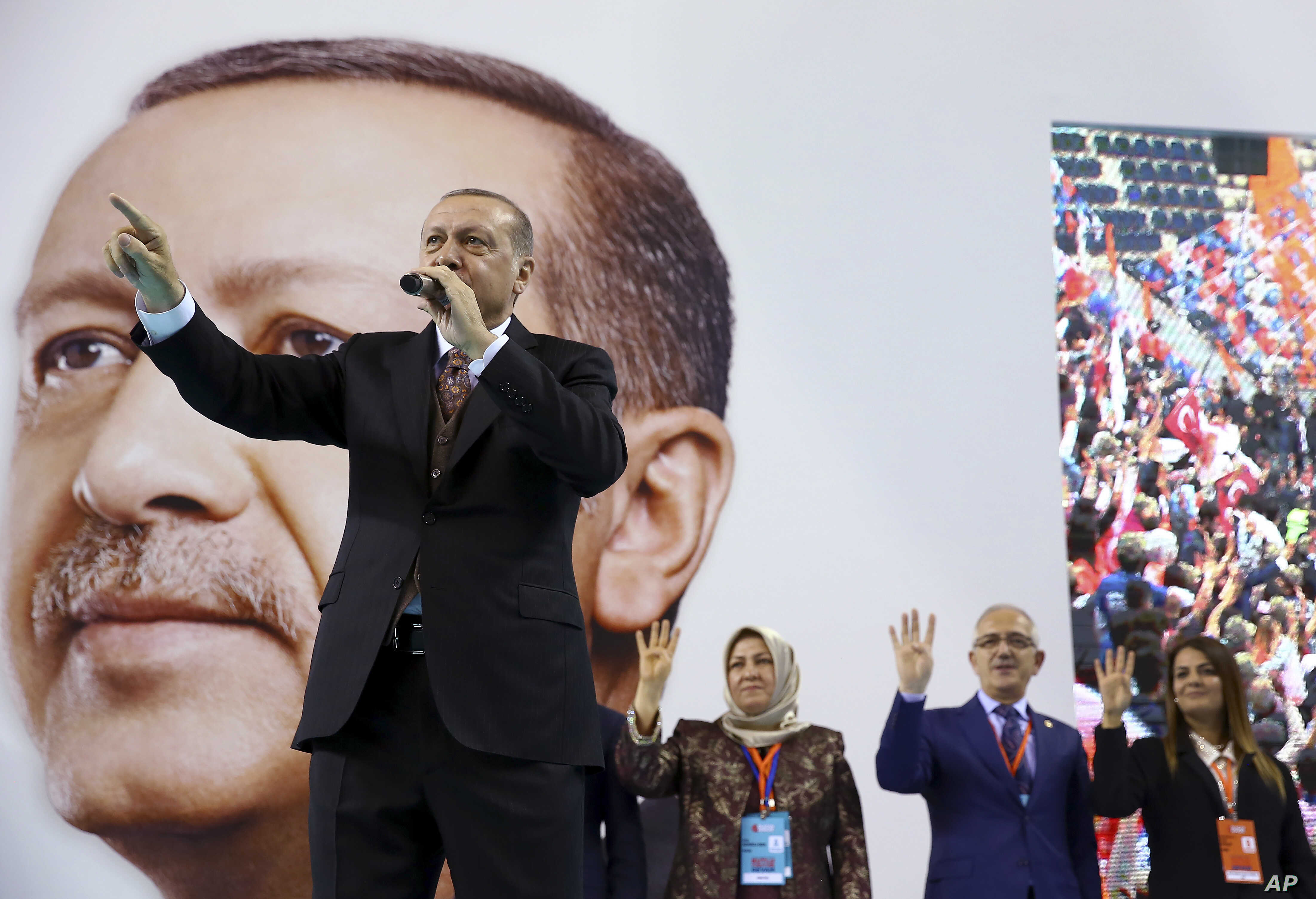 Turkey's President Recep Tayyip Erdogan gestures as he speaks during a rally of his ruling Justice and Development Party's supporters, in Mersin, southern Turkey, March 10, 2018. Erdogan has criticized NATO for not supporting the country's military o...