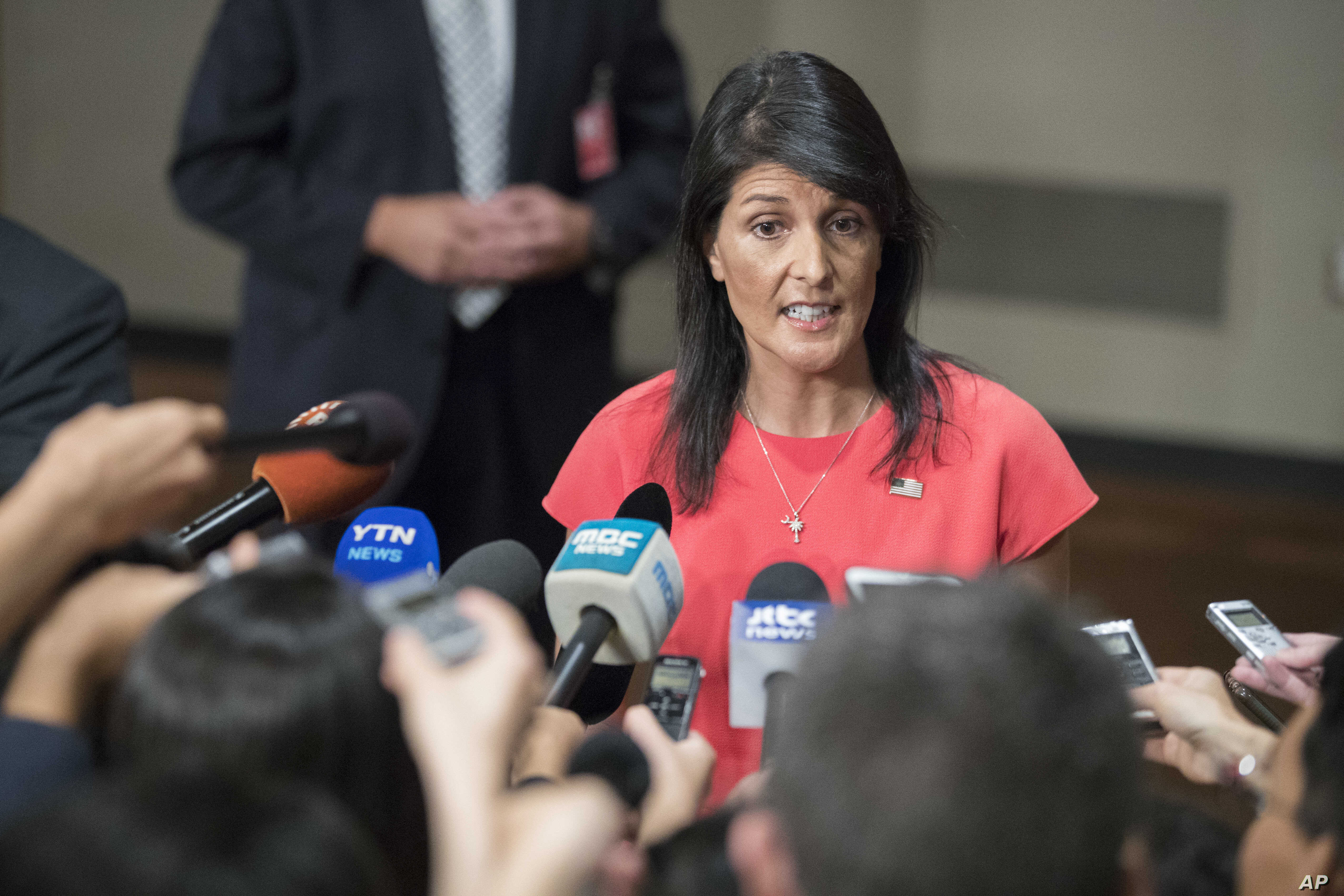 U.S. Ambassador to the United Nations Nikki Haley speaks to reporters after a Security Council vote on a new sanctions resolution that would increase economic pressure on North Korea to return to negotiations on its missile program, Aug. 5, 2017 at U...