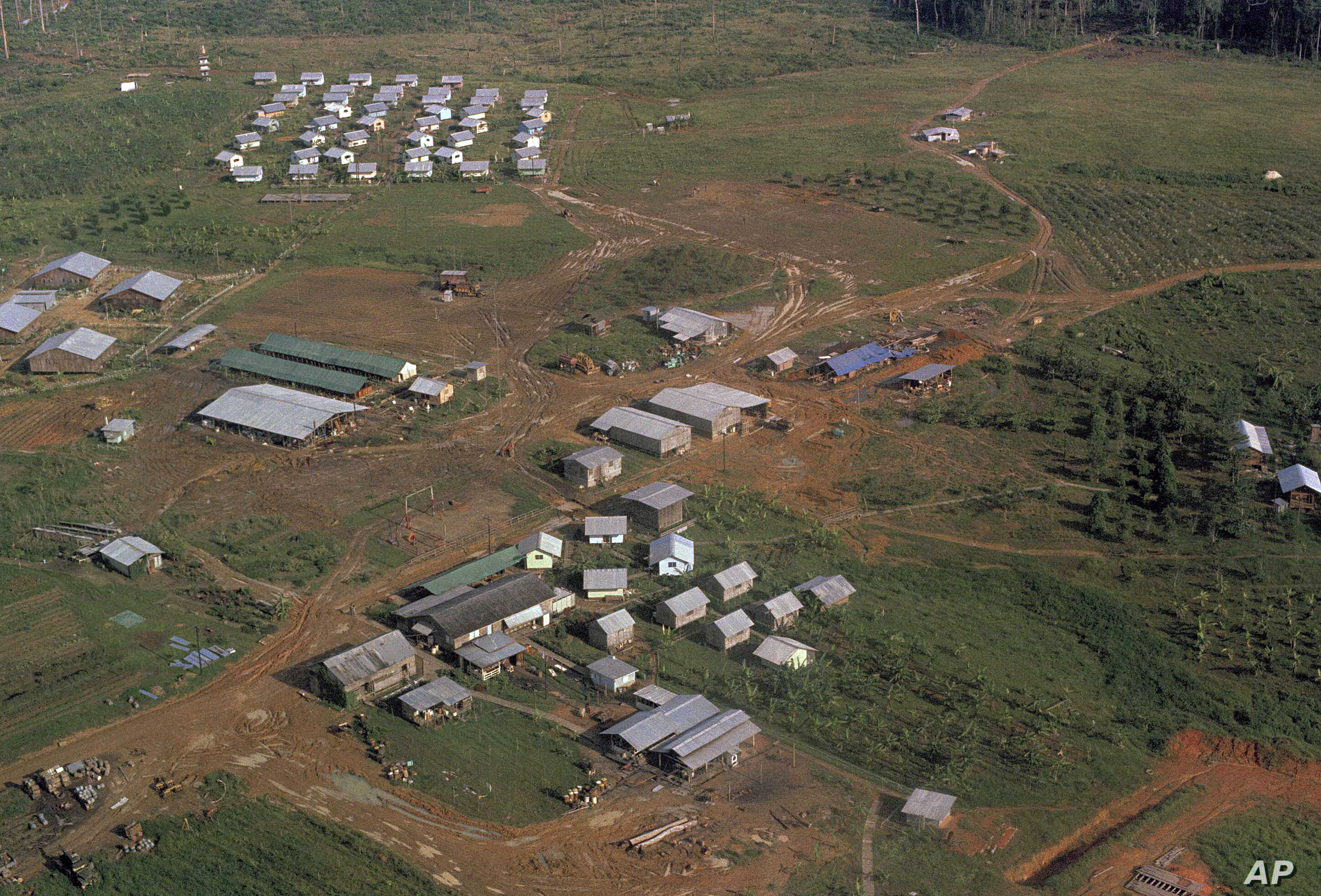 FILE - This Nov. 1978 file photo shows the Peoples Temple compound, led by Jim Jones, after bodies were removed, in Jonestown, Guyana.