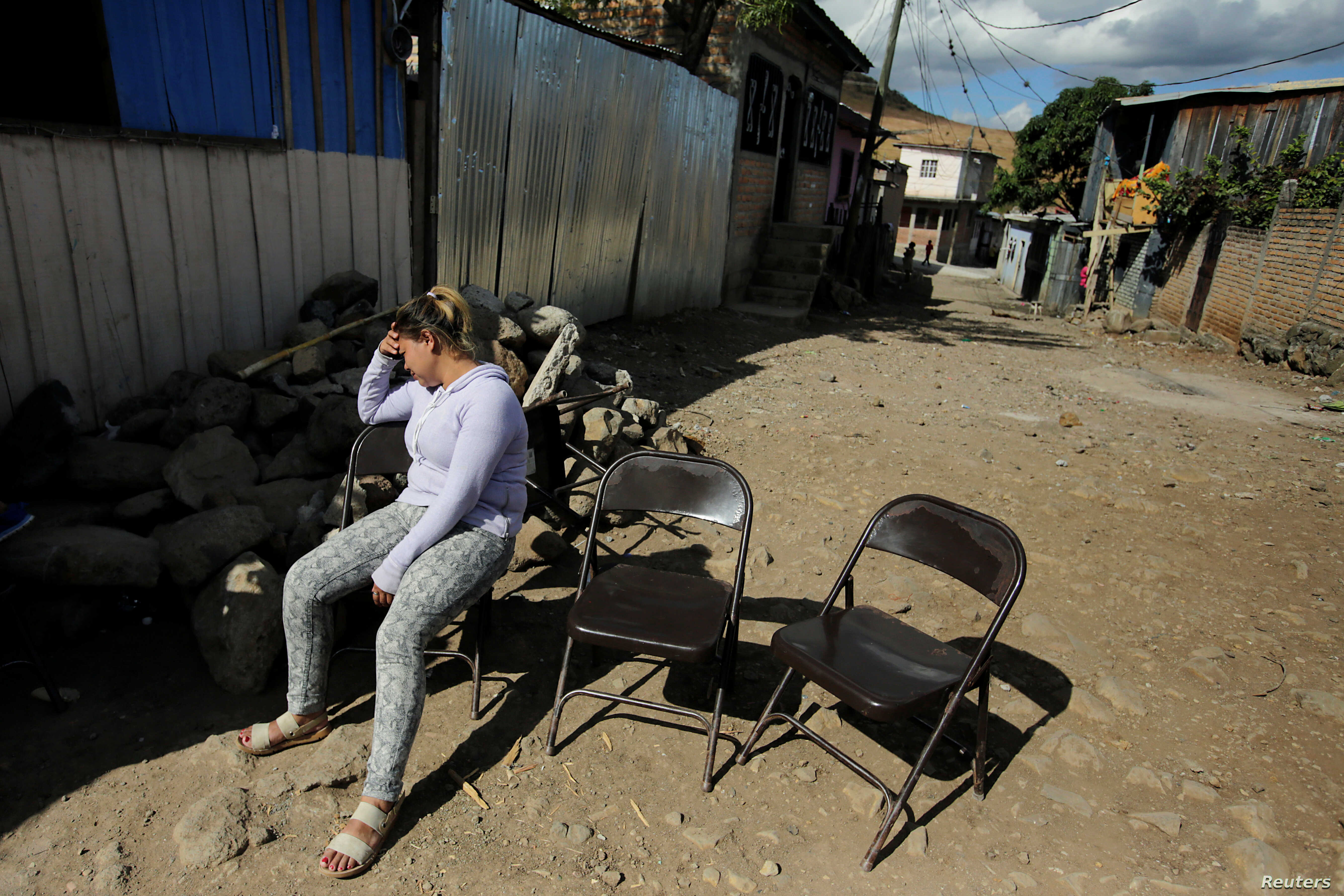 Alicia Espinal reacts during the funeral of her brother Nelson Espinal, 28,  Dec. 19, 2018. who was shot to death the night before shortly after leaving his home in Tegucigalpa, Honduras.