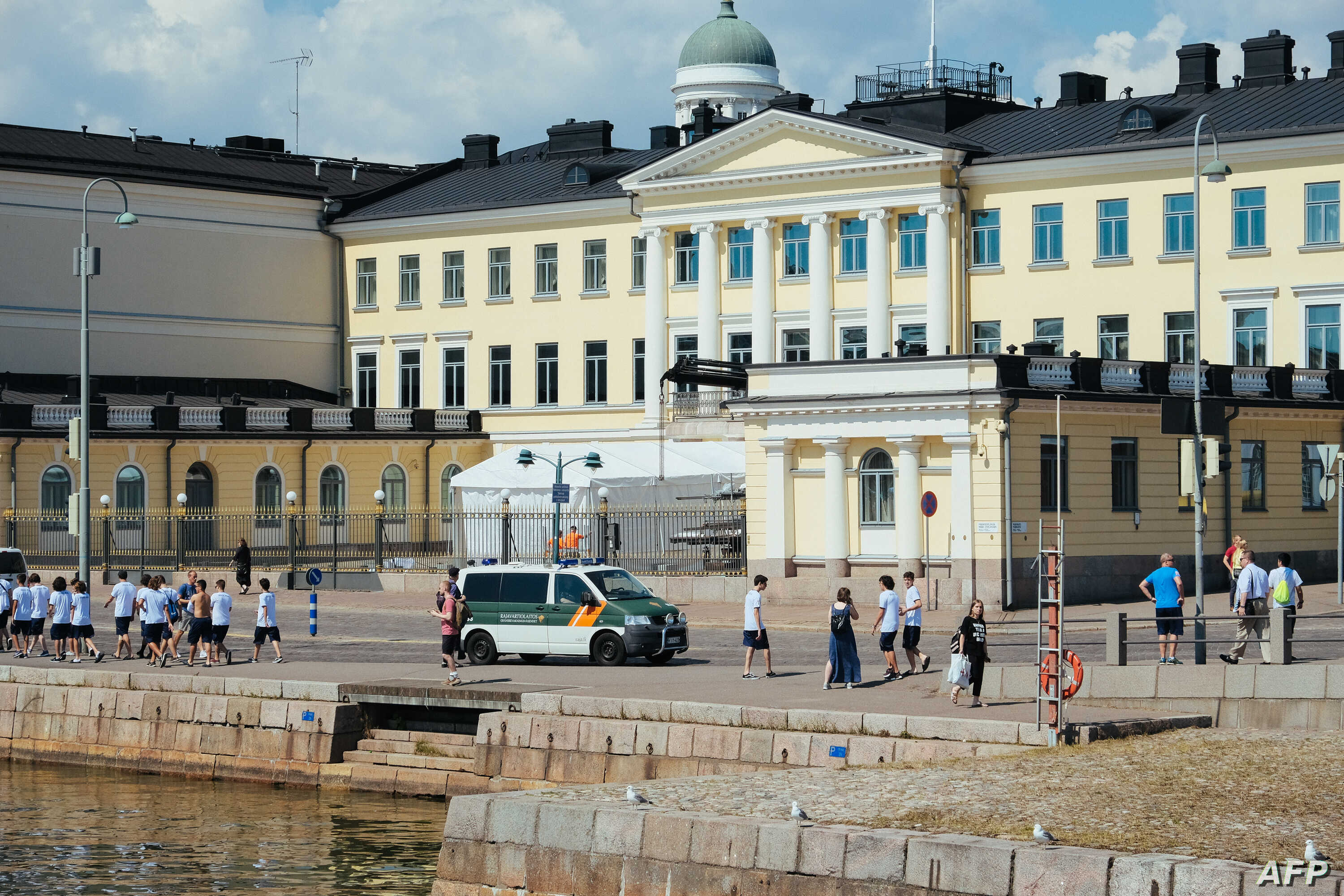 Police are seen in front of the Presidential Palace in Helsinki, Finland on July 14, 2018, ahead of the meeting between US President Donald Trump and his Russian counterpart Vladimir Putin.