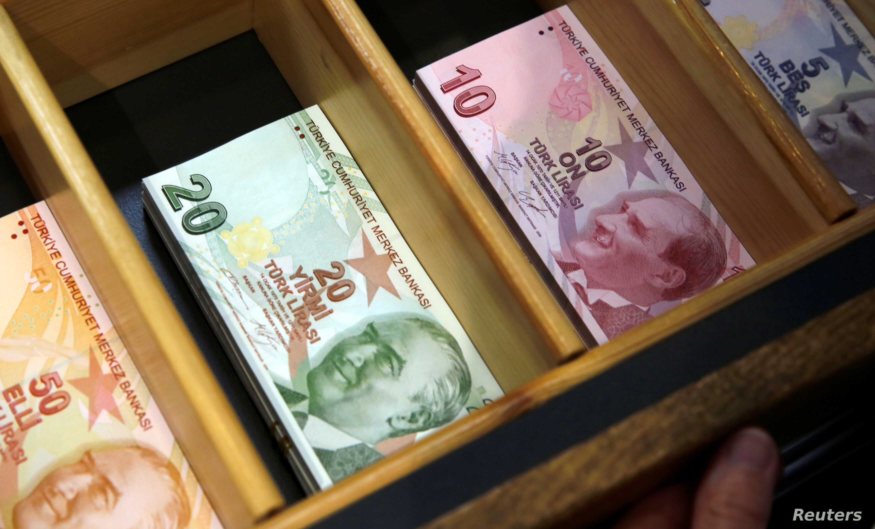 Turkish lira banknotes are pictured at a currency exchange office in Istanbul, Turkey, Aug. 13, 2018.