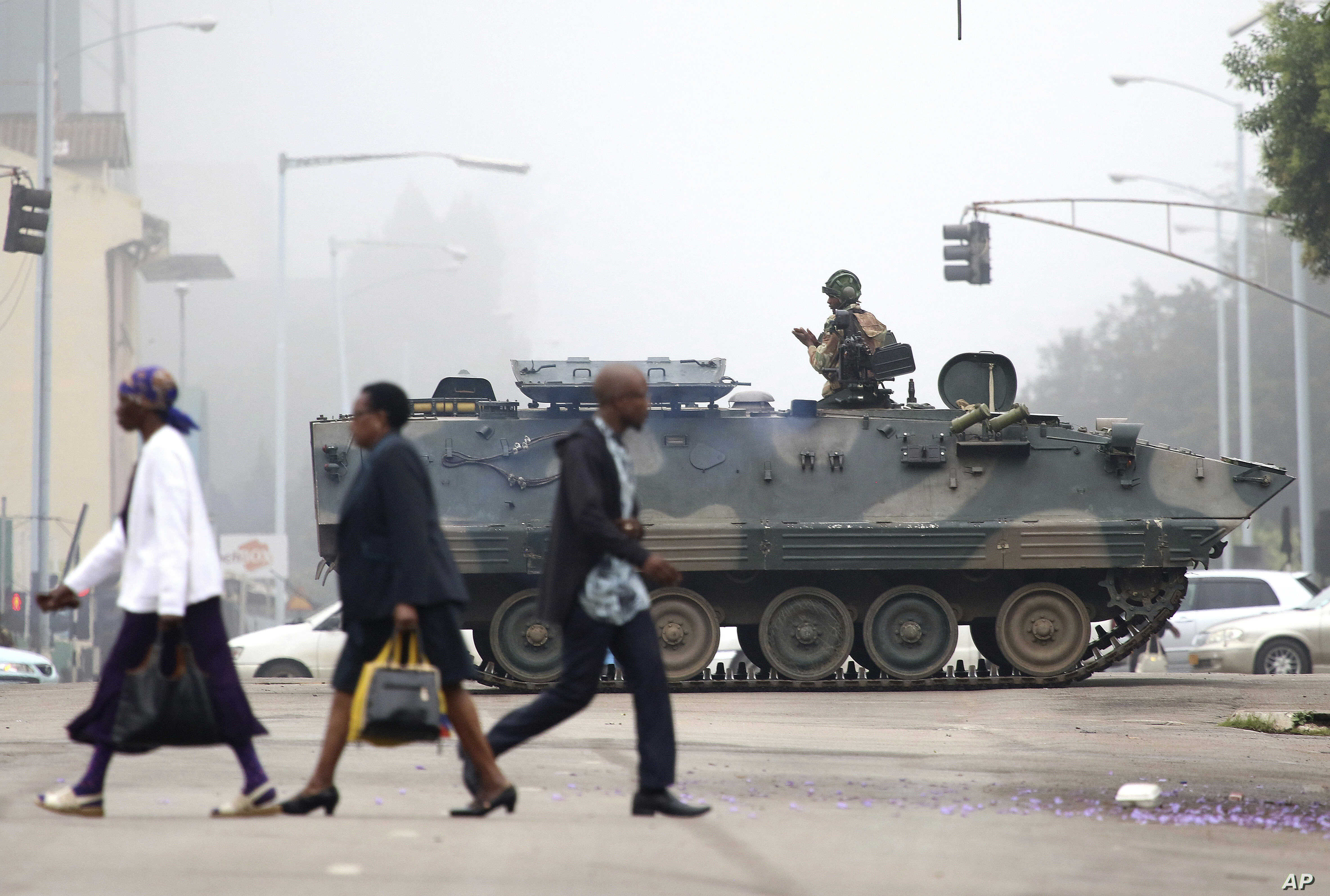 An armed soldier patrols a street in Harare, Zimbabwe, Nov. 15, 2017. Zimbabwe's army was securing government offices and patrolling the capital's streets following a night of unrest that included a military takeover of the state broadcaster.