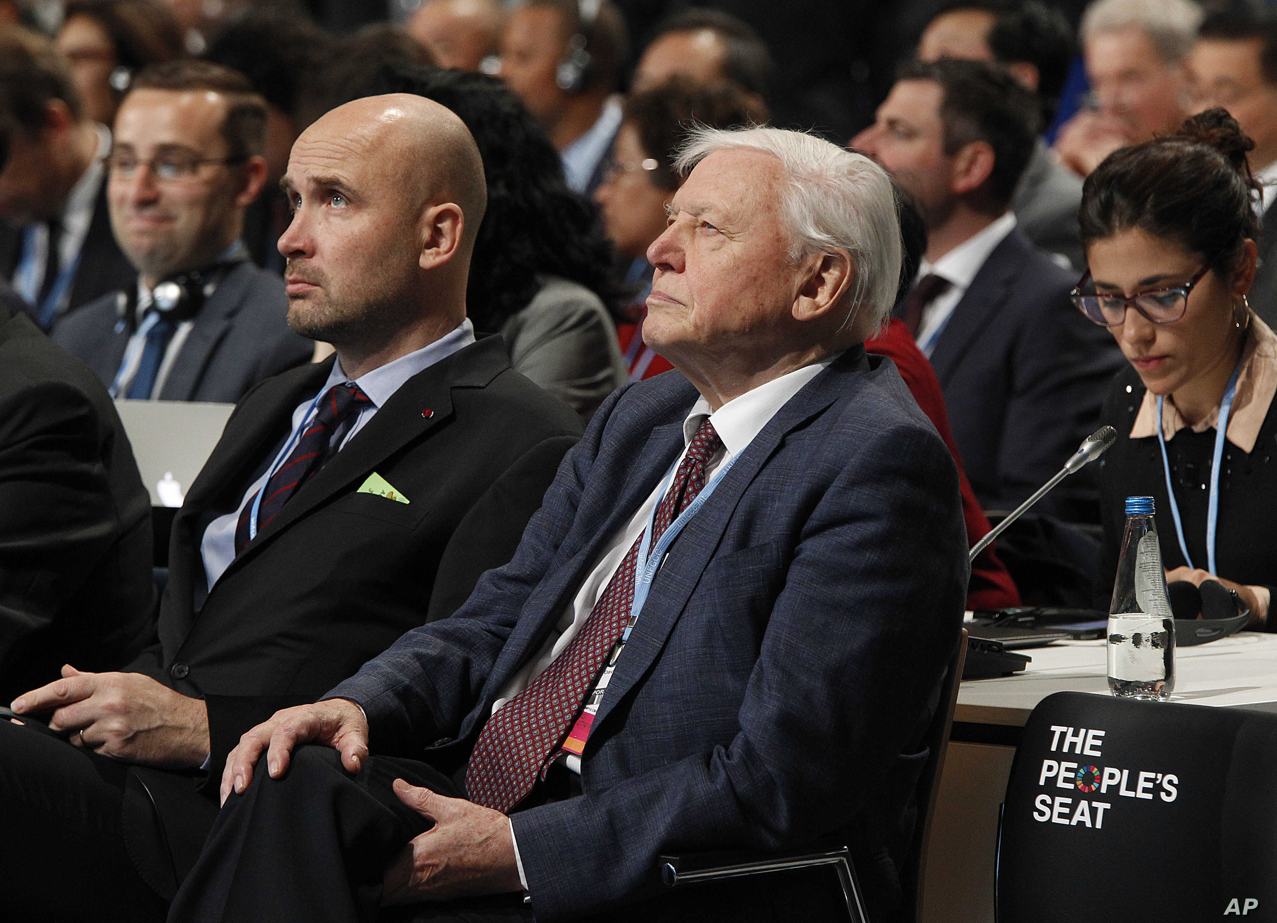Natural historian Sir David Attenborough, second right, listens to speeches during the opening of COP24 UN Climate Change Conference 2018 in Katowice, Poland, Dec. 3, 2018.
