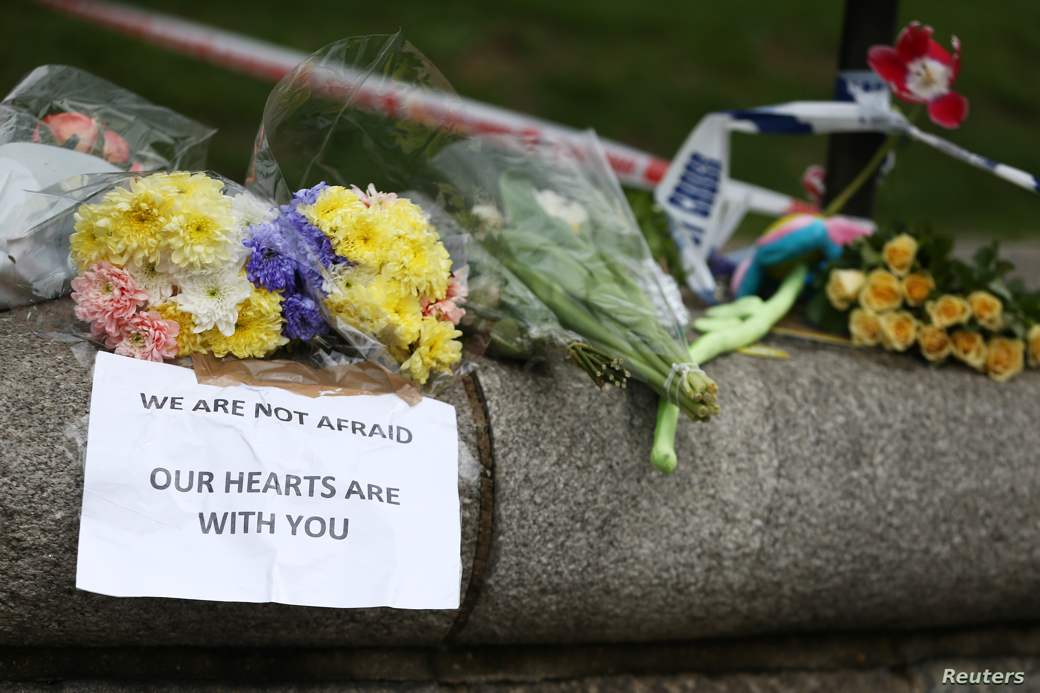 Flowers and messages are left near the scene of an attack by a man driving a car and weilding a knife left five people dead and dozens injured, in London, Britain, March 23, 2017.
