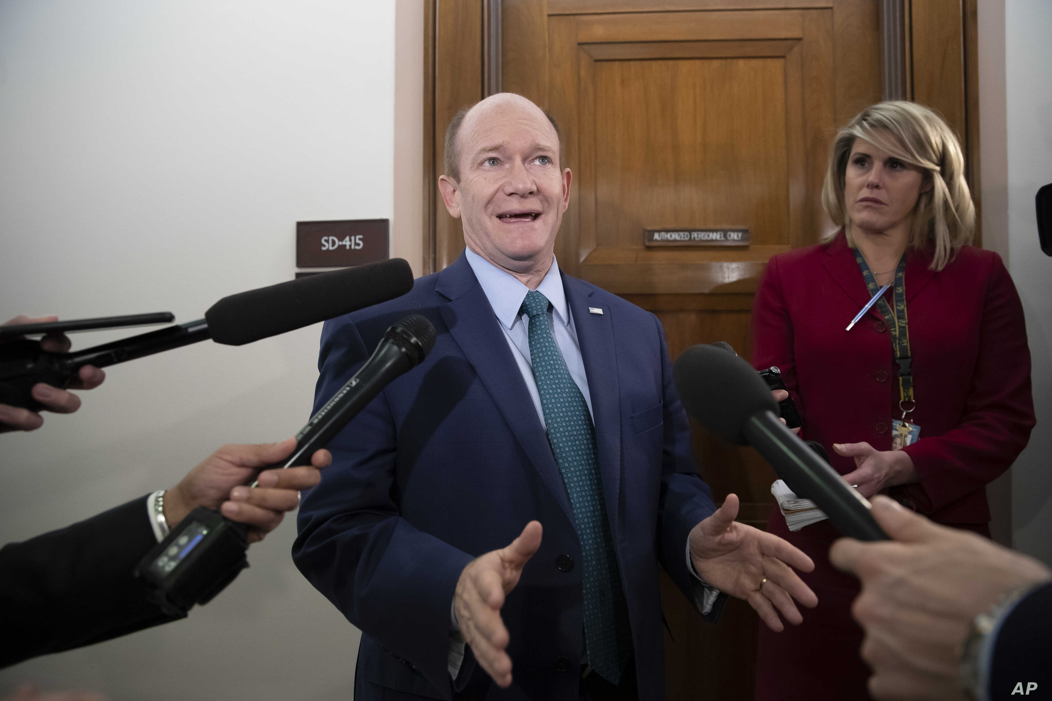 Sen. Chris Coons, D-Del., a member of the Senate Foreign Relations Committee, speaks with reporters as senators are considering multiple pieces of legislation in an effort to formally rebuke Saudi Arabia for the slaying of journalist Jamal Khashoggi,...