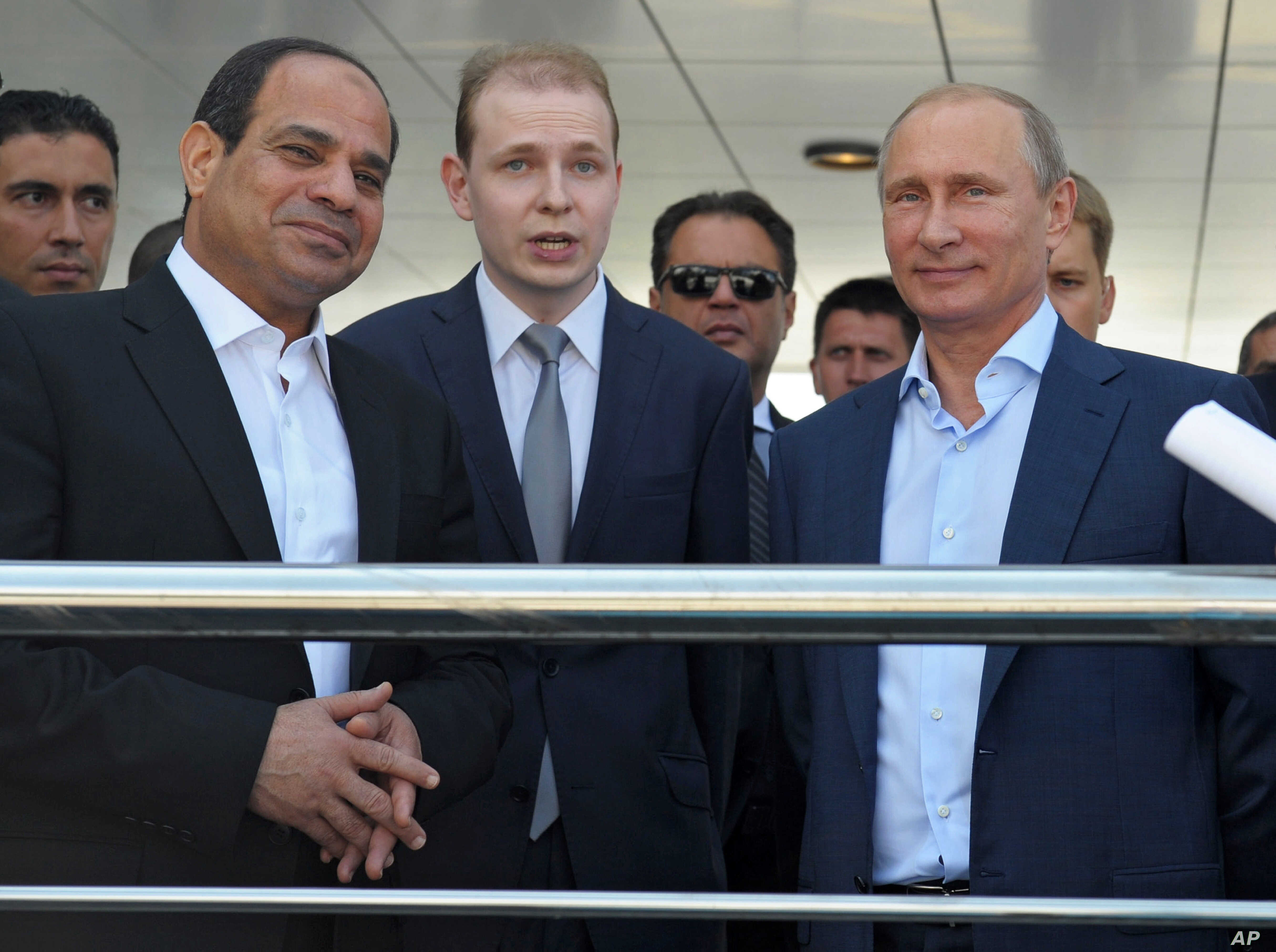 Russian President Vladimir Putin, right, and Egyptian President Abdel-Fattah el-Sissi, second left, listen to a translator during a meeting in the Russian Black Sea resort of Sochi, Russia, Aug. 12, 2014.