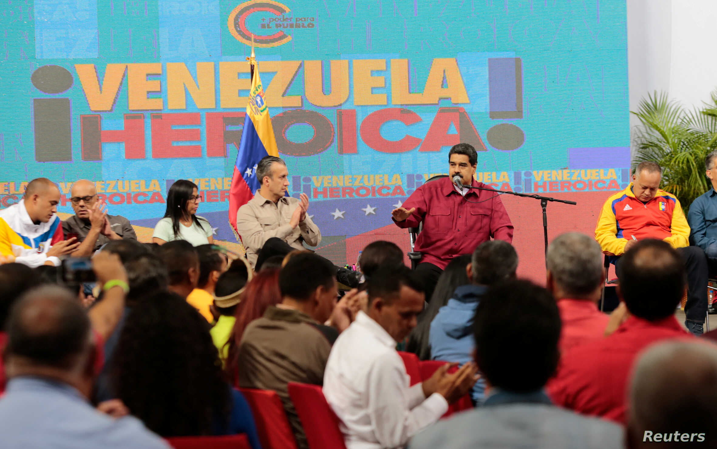 """Venezuela's President Nicolas Maduro, 2nd right, speaks during a meeting with members of the Constituent Assembly in Caracas, Venezuela, Aug. 2, 2017. The text in the back reads, """"Heroic Venezuela."""""""