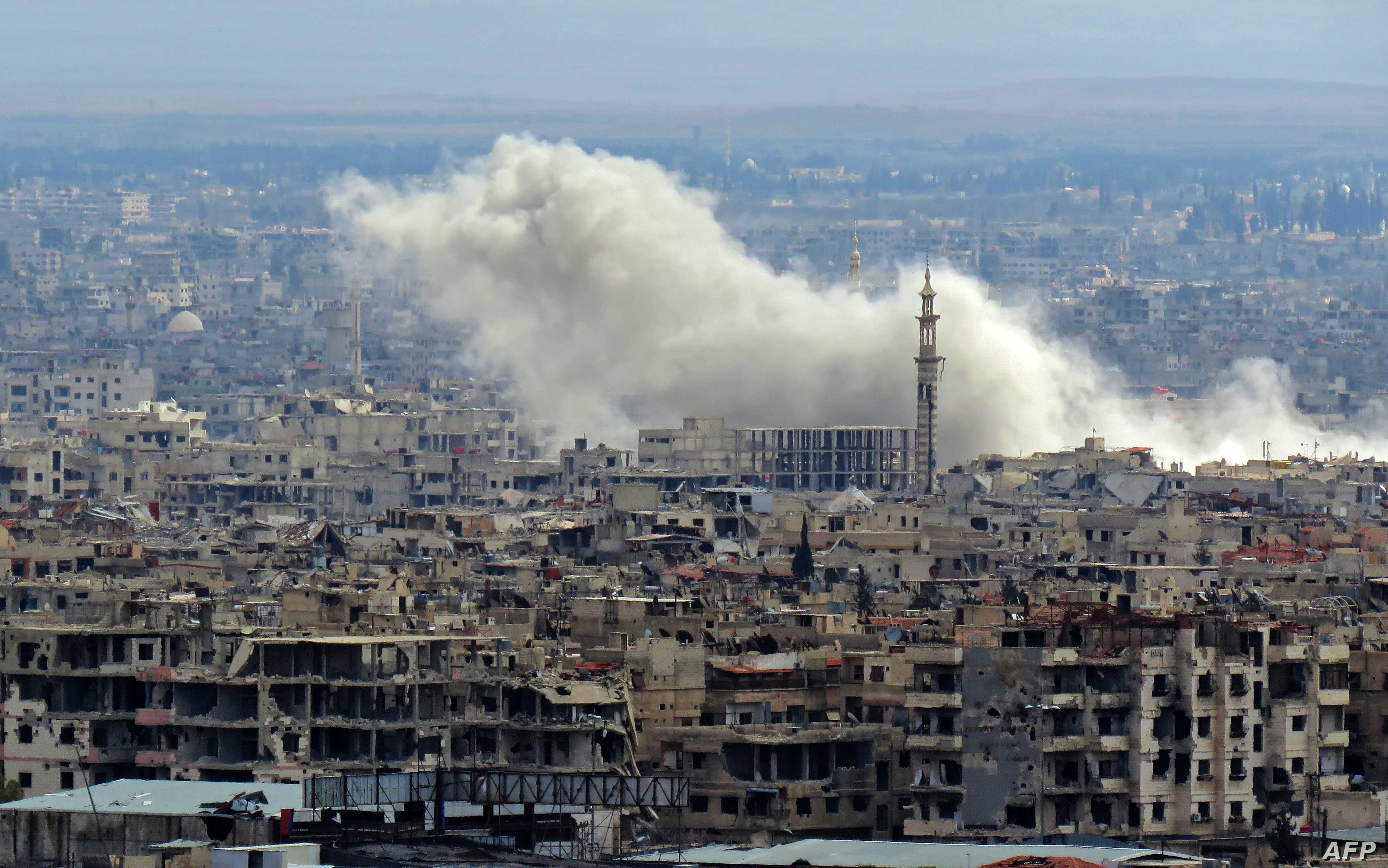 A general view taken from a government-held area in Damascus shows smoke rising from the rebel-held enclave of Eastern Ghouta on the outskirts of the Syrian capital following fresh air strikes and rocket fire on February 27, 2018.