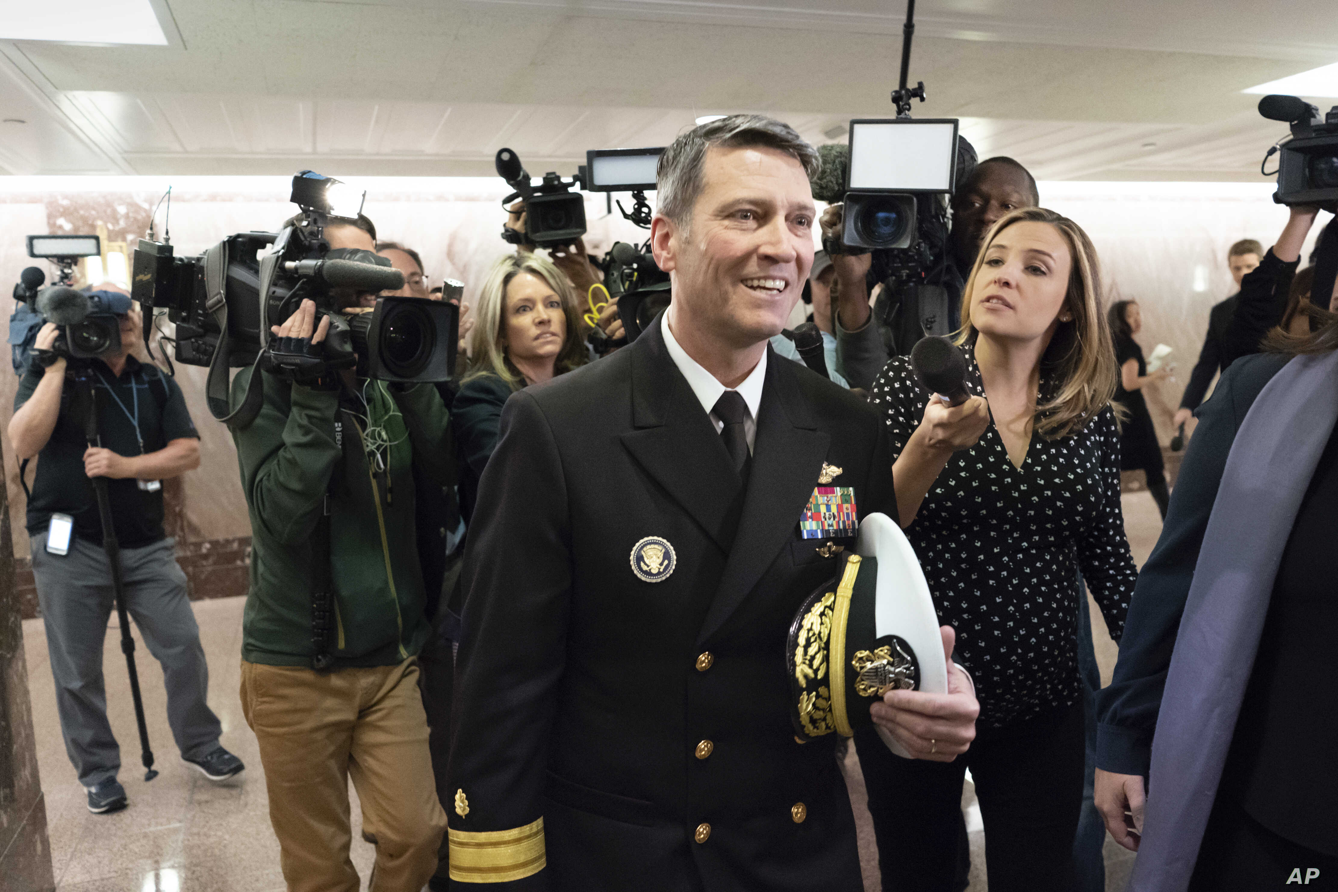 Rear Adm. Ronny Jackson, President Donald Trump's choice to be secretary of the Department of Veterans Affairs, leaves a Senate office building after meeting individually with some members of the committee that would vet him for the post, on Capitol