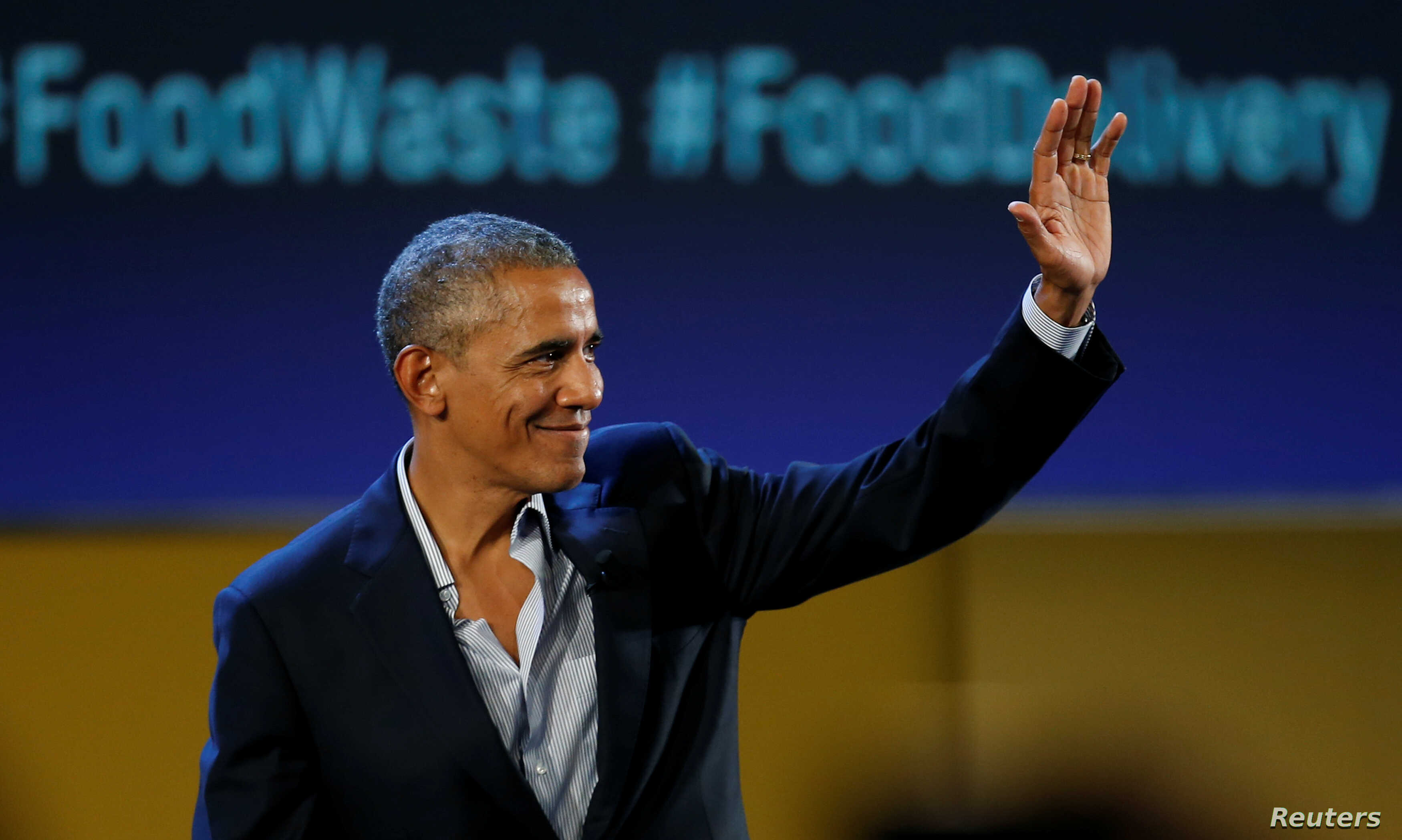 Former U.S. President Barack Obama waves after speaking at the Global Food Innovation Summit in Milan, Italy, May 9, 2017.