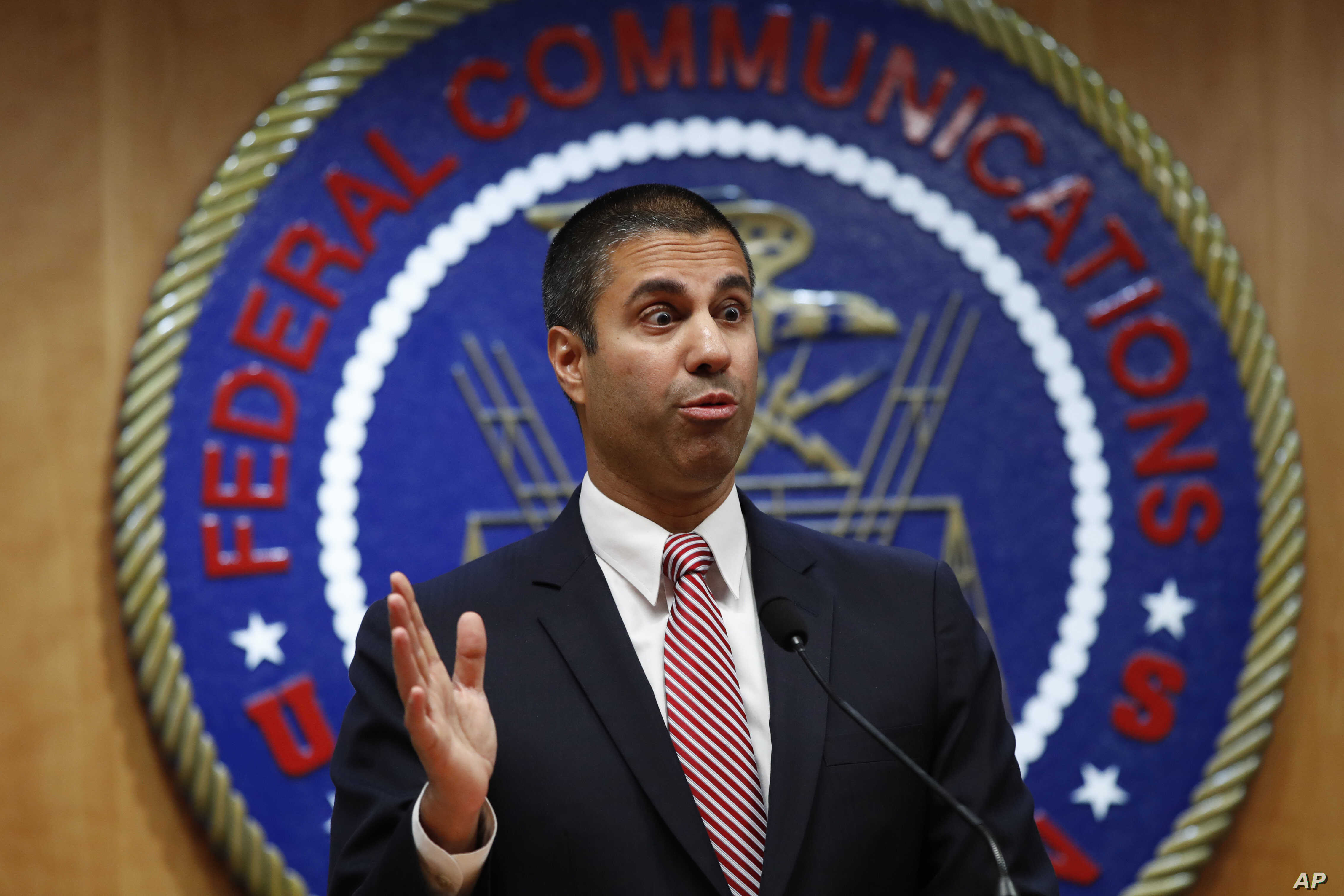 After a meeting voting to end net neutrality, Federal Communications Commission (FCC) Chairman Ajit Pai answers a question from a reporter, Dec. 14, 2017, in Washington.
