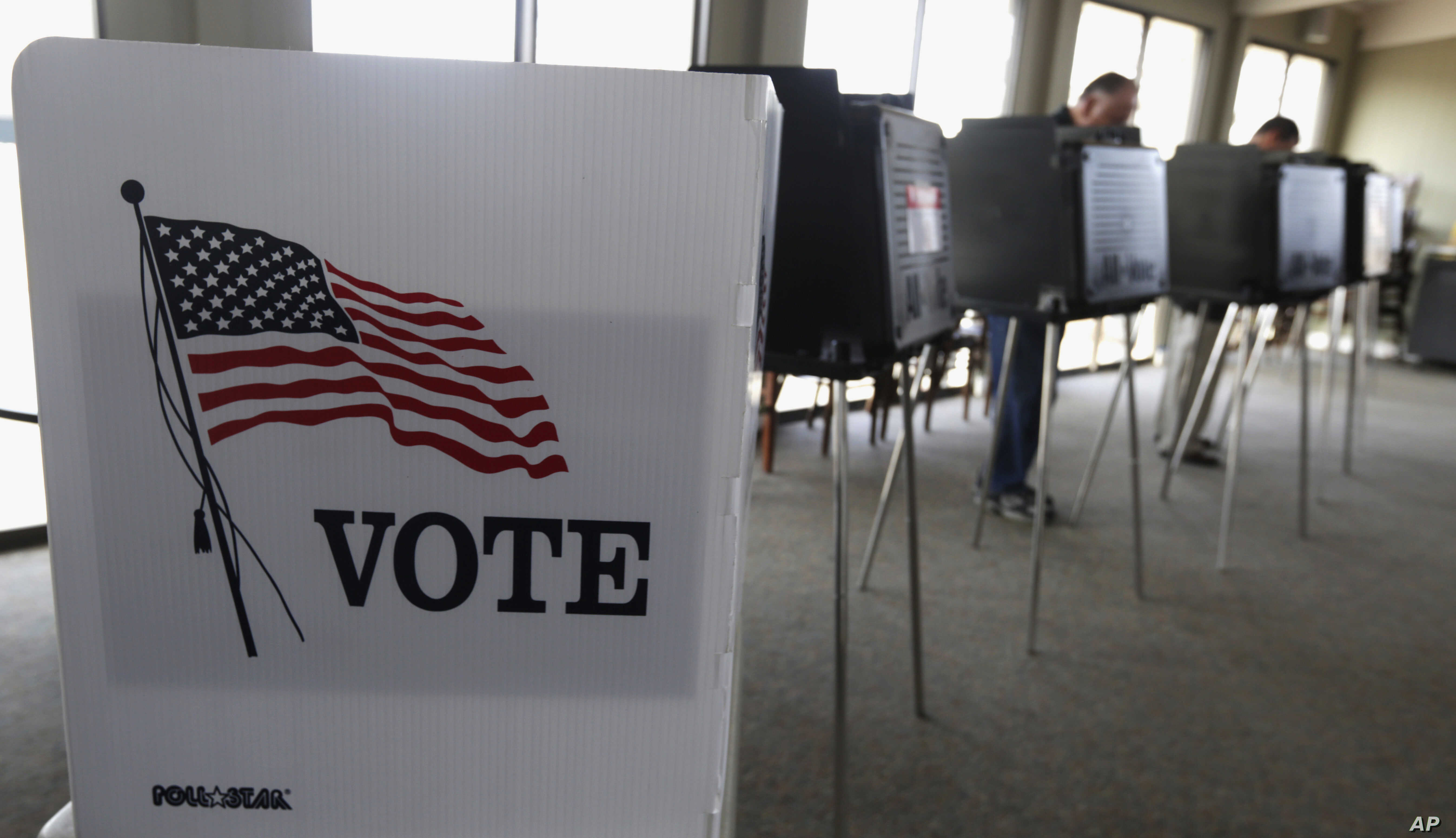 FILE - Voters cast ballots in the Illinois primary in Hinsdale, Ill., March 18, 2014. Illinois' top election officials insist that a recent hack into state voter rolls, which contain the names of 8 million active voters, does not pose a threat to the...