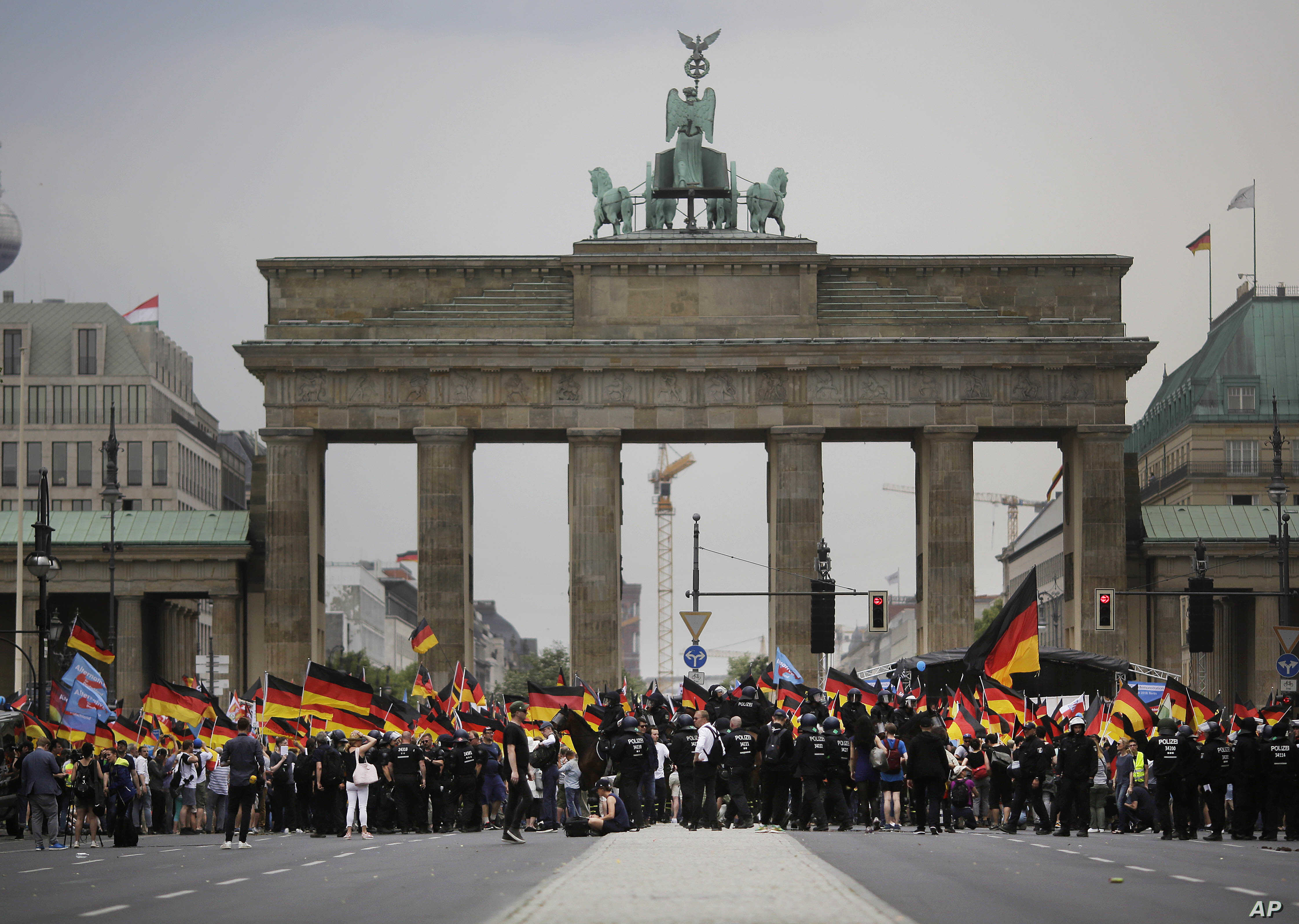 AfD supporters wave flags in front of the Brandenburg Gate in Berlin, Germany, May 27, 2018. The AfD swept into Parliament last year on a wave of anti-migrant sentiment.