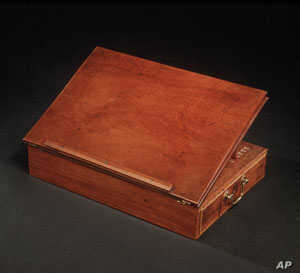 In 1776, Thomas Jefferson wrote the Declaration of Independence on this portable lap desk of his own design.