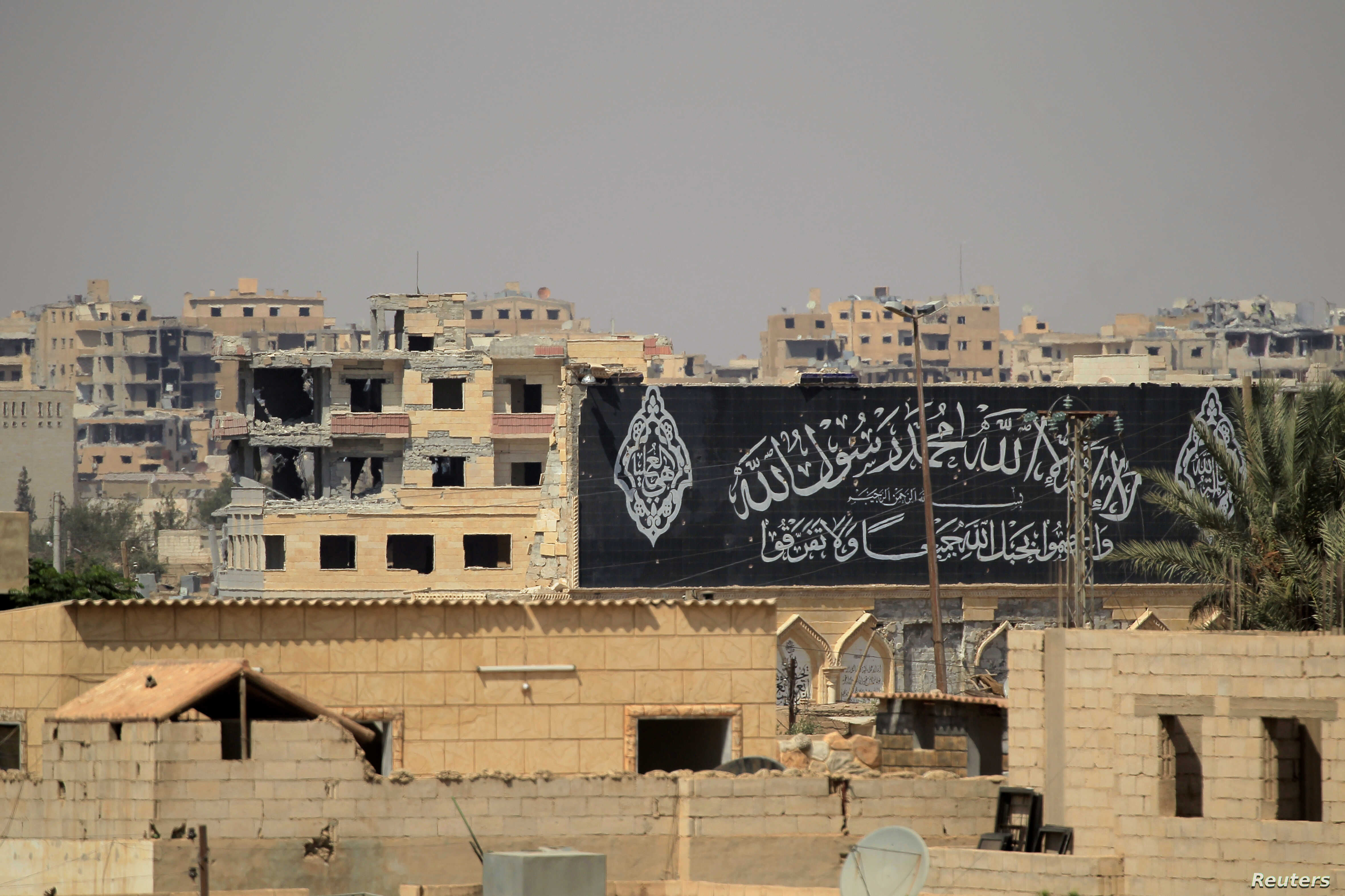A banner belonging to Islamic States fighters is seen during a battle with members of the Syrian Democratic Forces in Raqqa, Syria, Aug. 16, 2017.