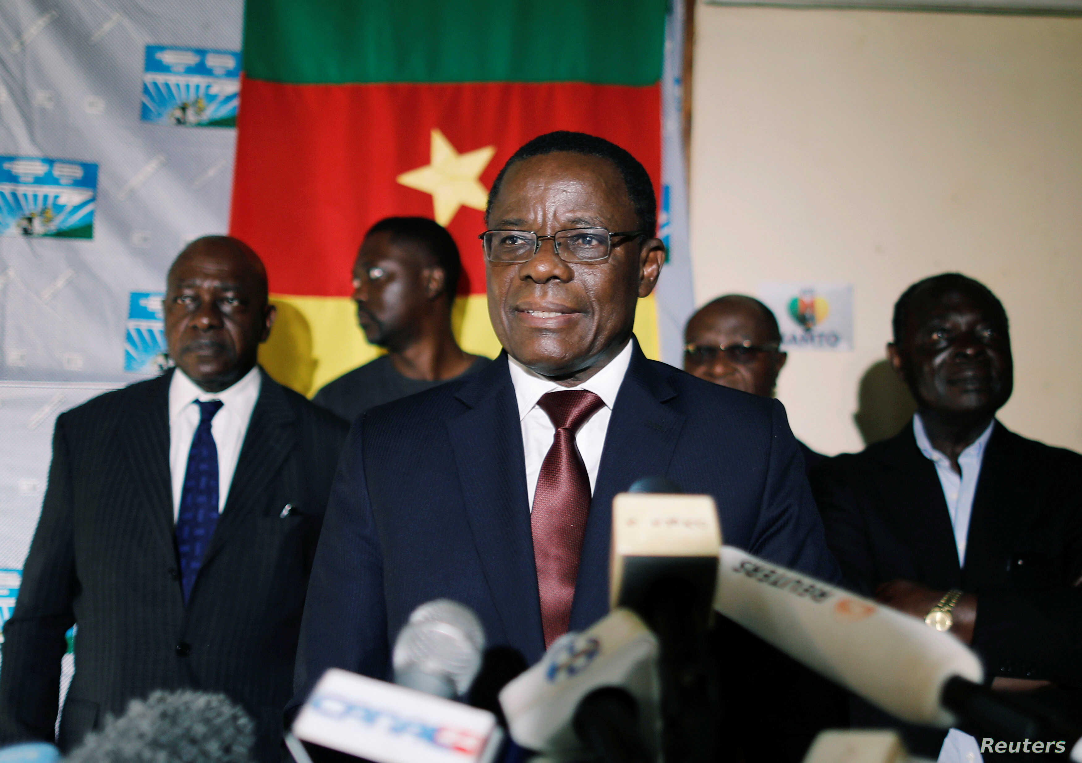 Maurice Kamto, a presidential candidate of Renaissance Movement (MRC), reacts as he holds a news conference at his headquarter in Yaounde, Cameroon, Oct. 8, 2018.